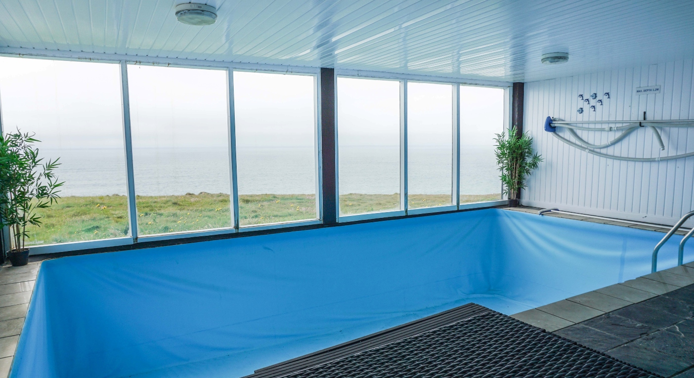 The indoor swimming pool overlooks the Irish Sea (SWNS)