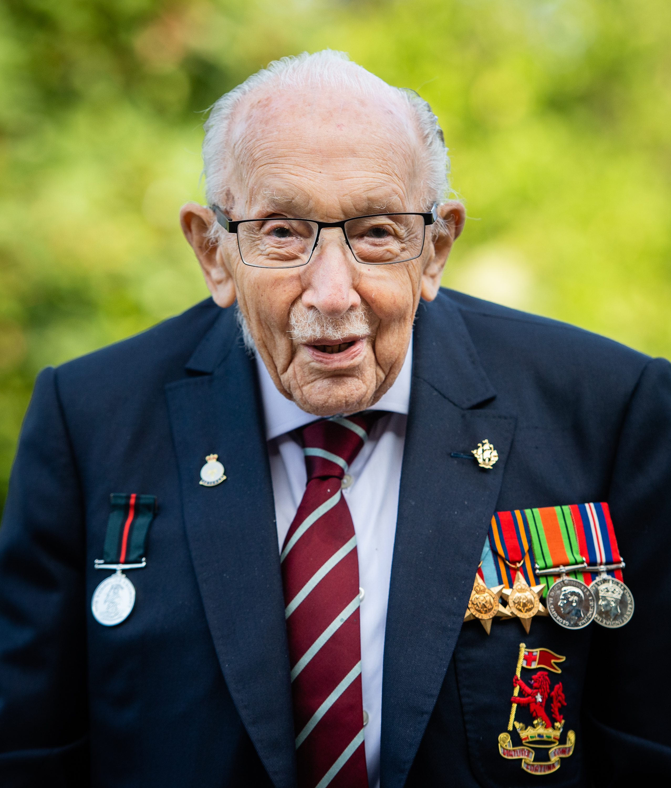 "Captain Sir Tom Moore poses during a photocall to mark the launch of his memoir ""Tomorrow Will Be A Good Day"" at The Coach House on September 17, 2020 in Milton Keynes, England. (Photo by Samir Hussein/WireImage)"