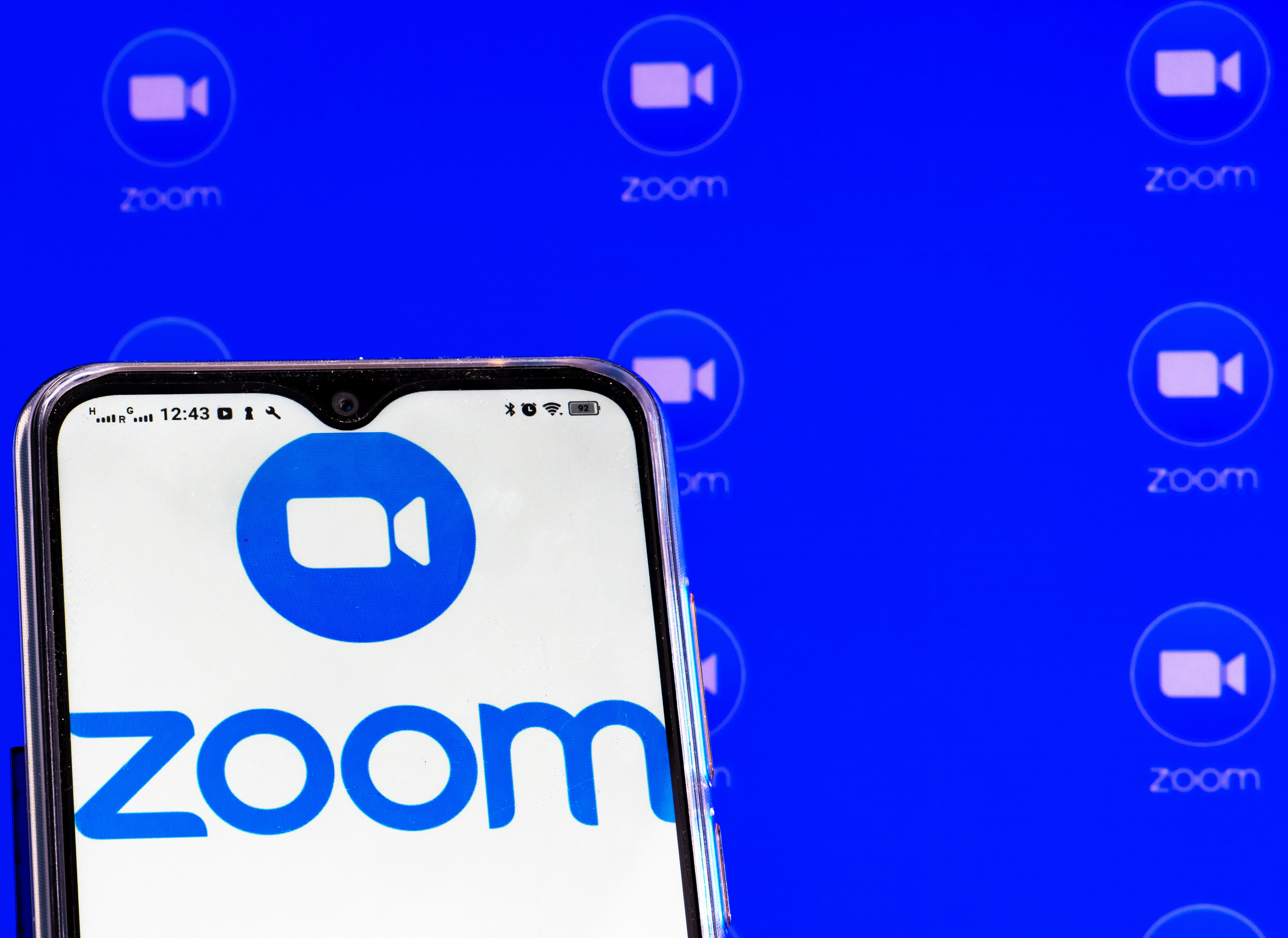 UKRAINE - 2021/02/01: In this photo illustration a Zoom Video Communications, Inc. logo is seen displayed on a smartphone screen. (Photo Illustration by Igor Golovniov/SOPA Images/LightRocket via Getty Images)