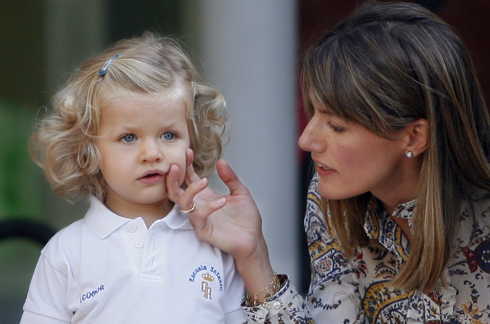 <p>Spain's Princess Letizia touches Princess Leonor to give her confidence as she faces photographers on her arrival to nursery school in El Pardo, outside Madrid, Friday, Sept. 7, 2007. (AP Photo/Daniel Ochoa de Olza)</p>