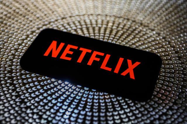 Netflix logo is seen displayed on a phone screen in this illustration photo taken in Poland on October 3, 2020.   (Photo Illustration by Jakub Porzycki/NurPhoto via Getty Images)
