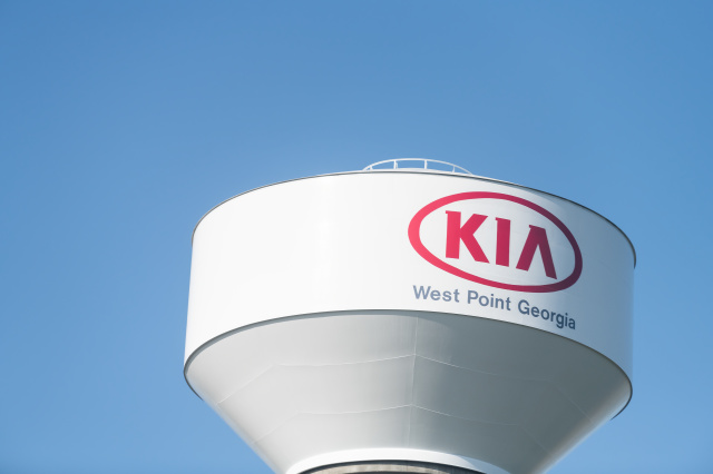 West Point, USA - April 21, 2018: Water tank, reservoir, tower in Georgia with logo, sign of Kia Motors Manufacturing plant, factory production