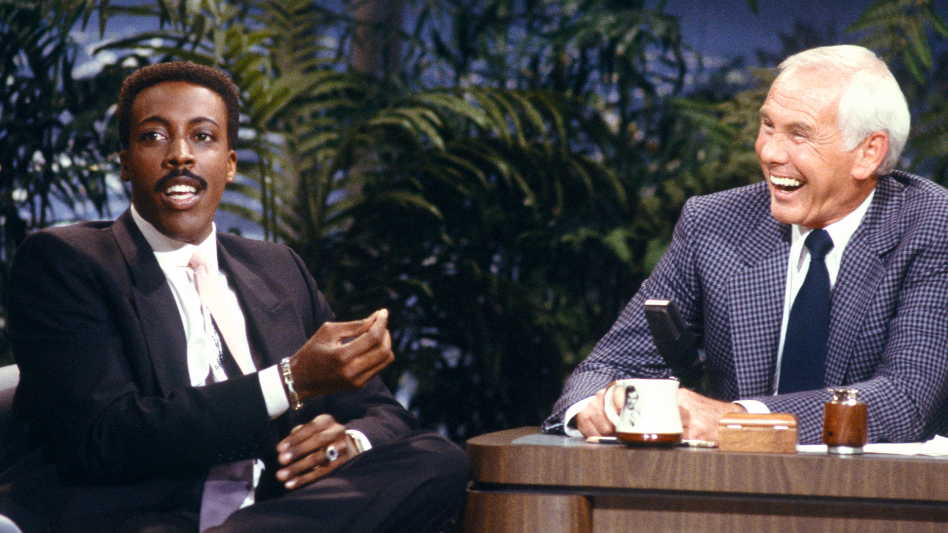 Arsenio Hall claims Johnny Carson helped book his guests despite being a rival late night host