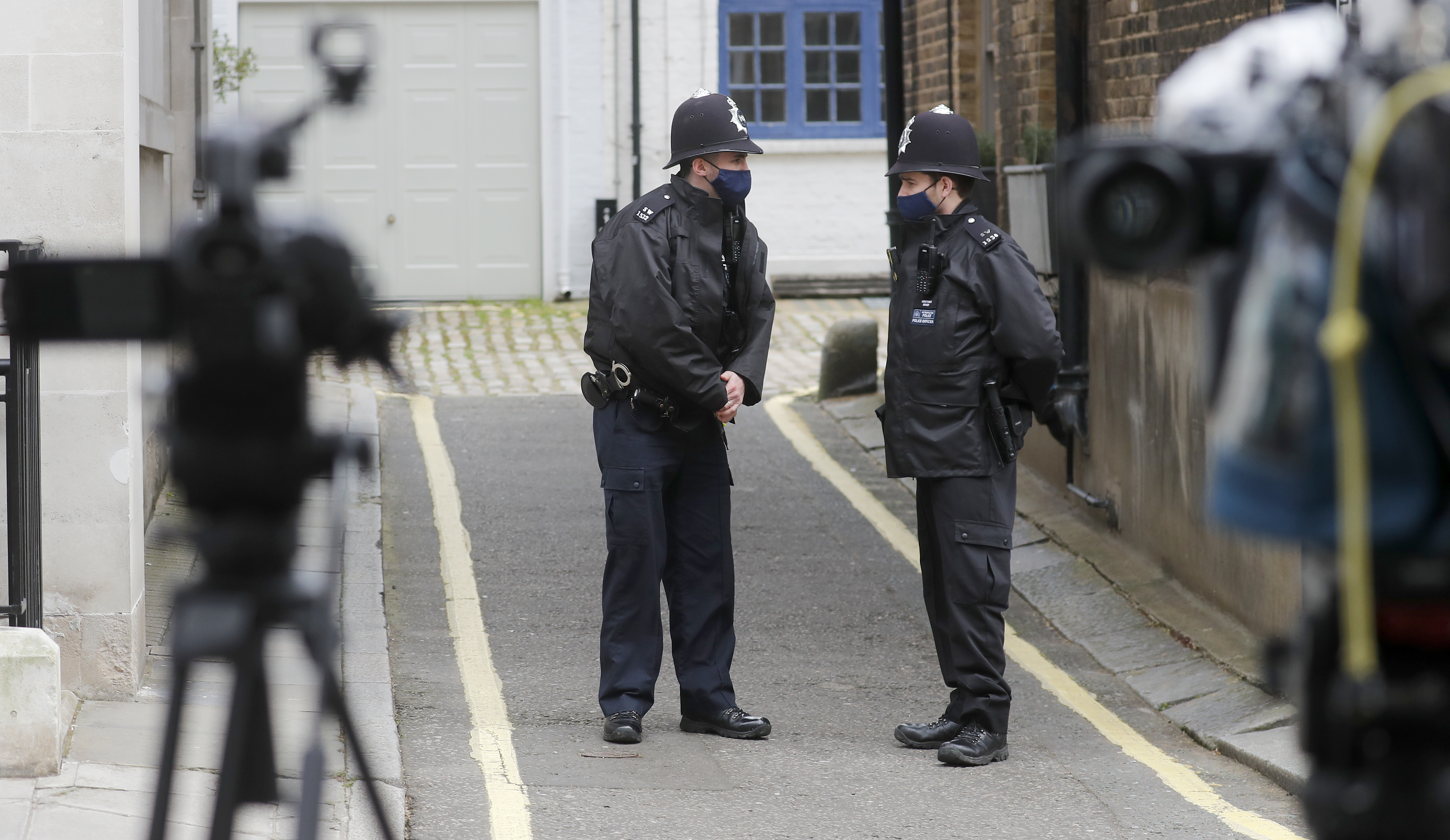 <p>Police officers stand outside King Edward VII hospital where Britain's Prince Philip is receiving treatment in London, Thursday March 11, 2021. The 99-year-old husband of Queen Elizabeth II remains hospitalized after a heart procedure. (AP Photo/Frank Augstein)</p>