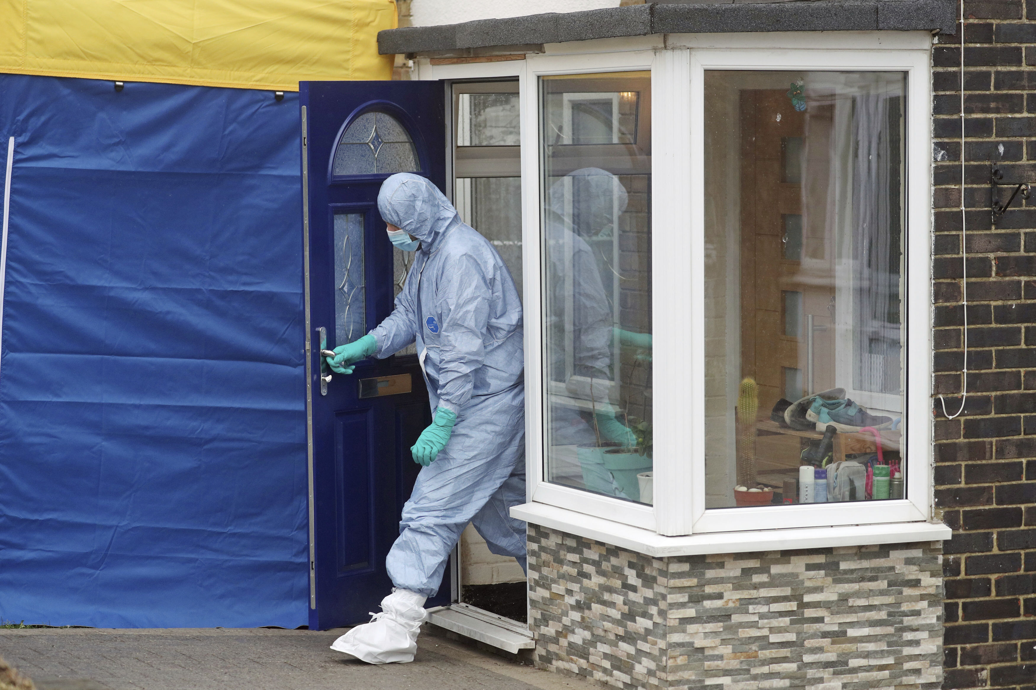 """<p>A forensic officer leaves a house in Freemens Way, in connection with missing woman Sarah Everard, in Deal, England, Wednesday March 10, 2021. Britain's Metropolitan police says an officer has been arrested in connection with the case of a woman who went missing in London last week. The force said the fact that the man is a serving police officer is """"shocking and deeply disturbing."""" Police said the officer was arrested late Tuesday in Kent, southeast of London, as part of the investigation into the disappearance of Sarah Everard. (Steve Parsons/PA via AP)</p>"""