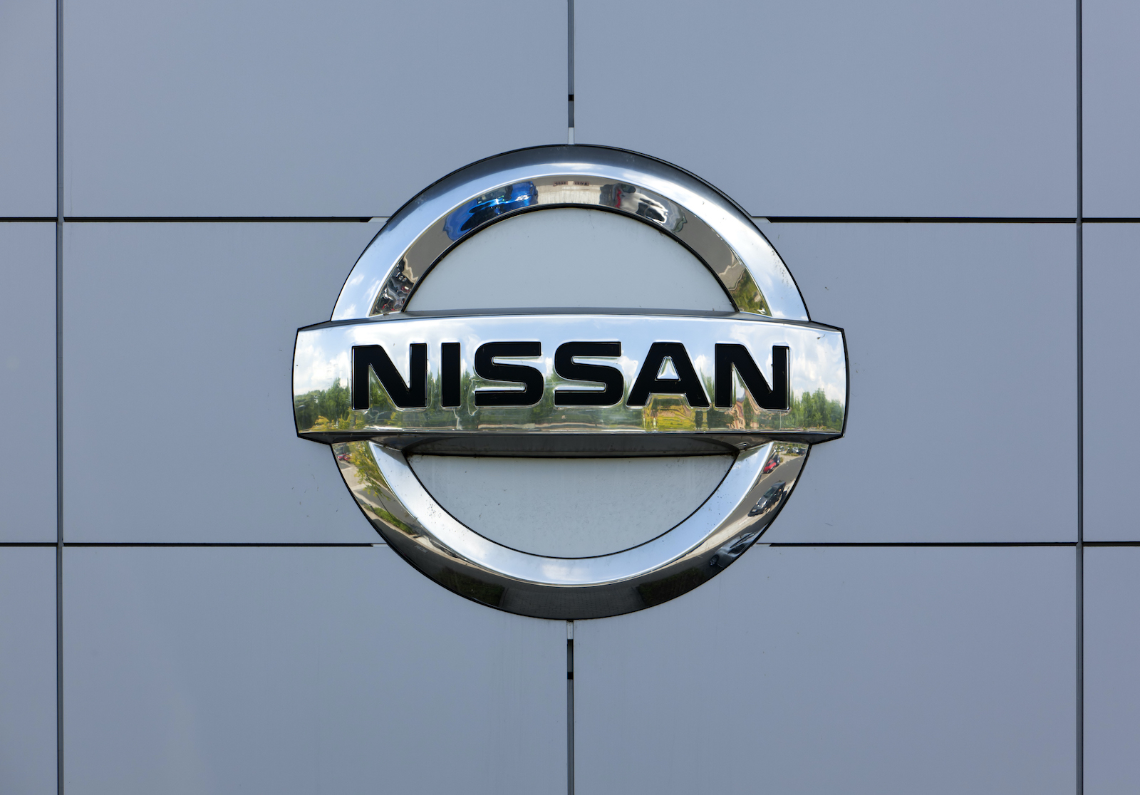 Dusseldorf, Germany - June 12, 2011: Nissan logo at the wall of car dealer's building. Nissan Motor Company Ltd is a mulrinational car manufacturer headquartered in Yokohama, Japan.