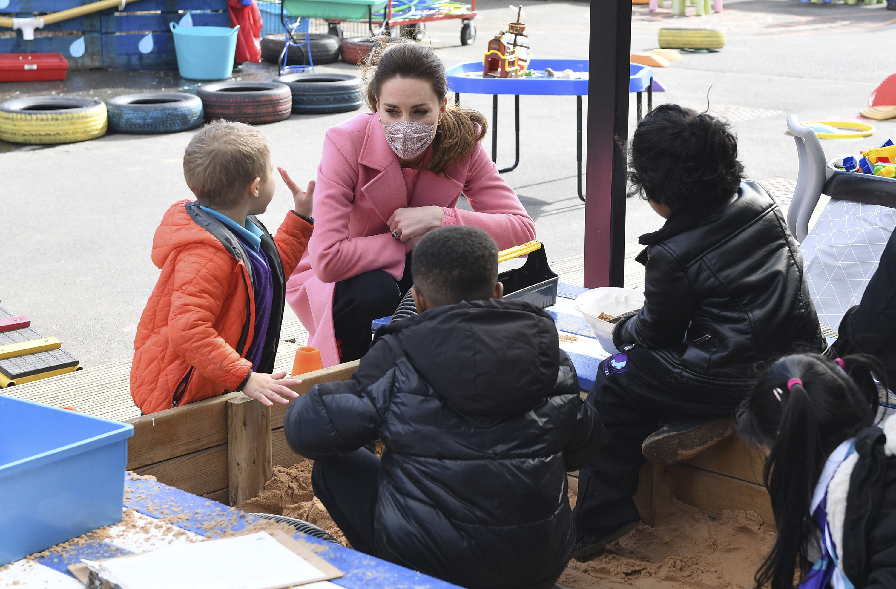 <p>Britain's Kate, Duchess of Cambridge talks with a group of children in the playground during a visit with Prince William to School21, a school in east London, Thursday March 11, 2021. (Justin Tallis/Pool via AP)</p>