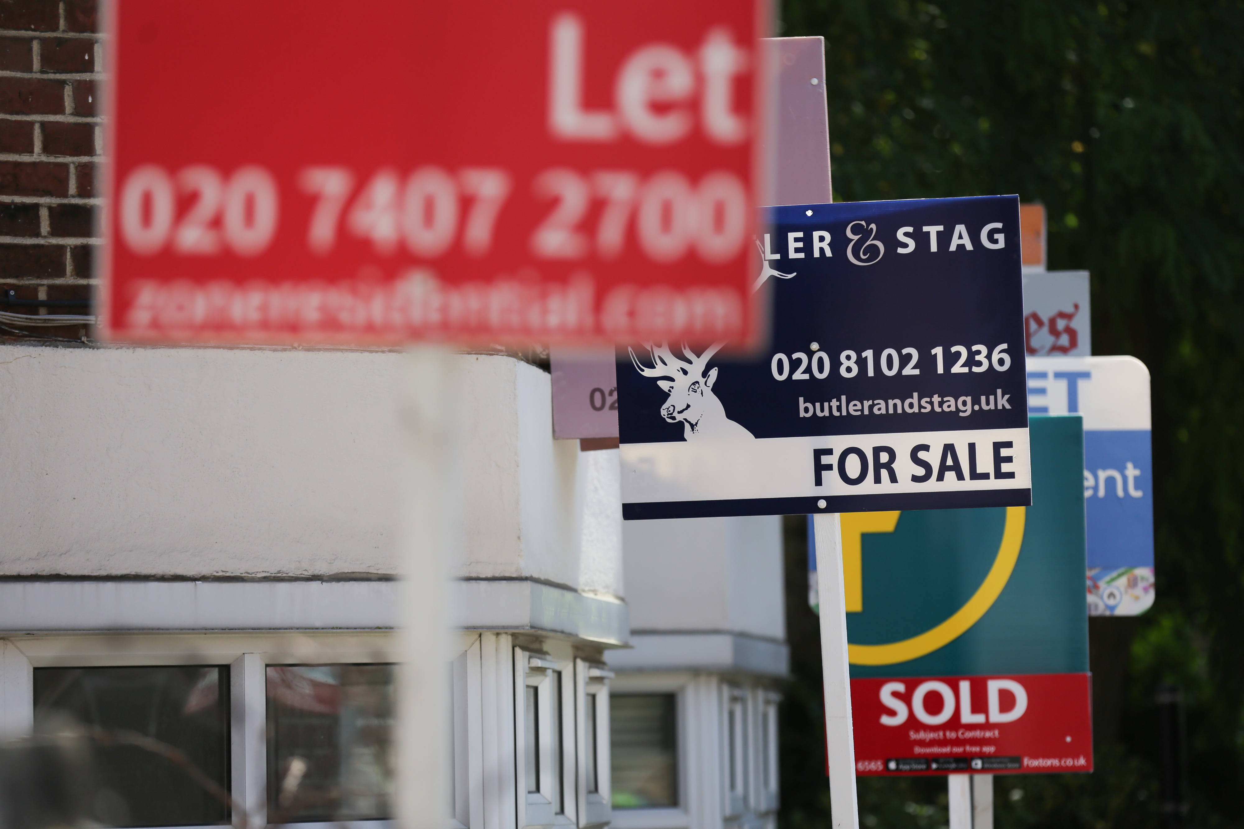 Estate agents placards are seen in front of houses in London on August 17, 2016  From computers and cars to carpets and food, Britain's decision to leave the EU is beginning to hit consumers in the pocket, having already spread uncertainty through the property market. There are fears over the UK housing market, but deflation is more of a concern than price rises in this key sector. Figures released Monday showed that residential rents for new lets in London had fallen for the first time in six years. In addition, homeowners have seen the value of their property rise on average by just 2.1 percent in the year up tol August, a slowdown from the breakneck growth of recent years, according to property website Rightmove.  / AFP PHOTO / Daniel LEAL-OLIVAS        (Photo credit should read DANIEL LEAL-OLIVAS/AFP via Getty Images)