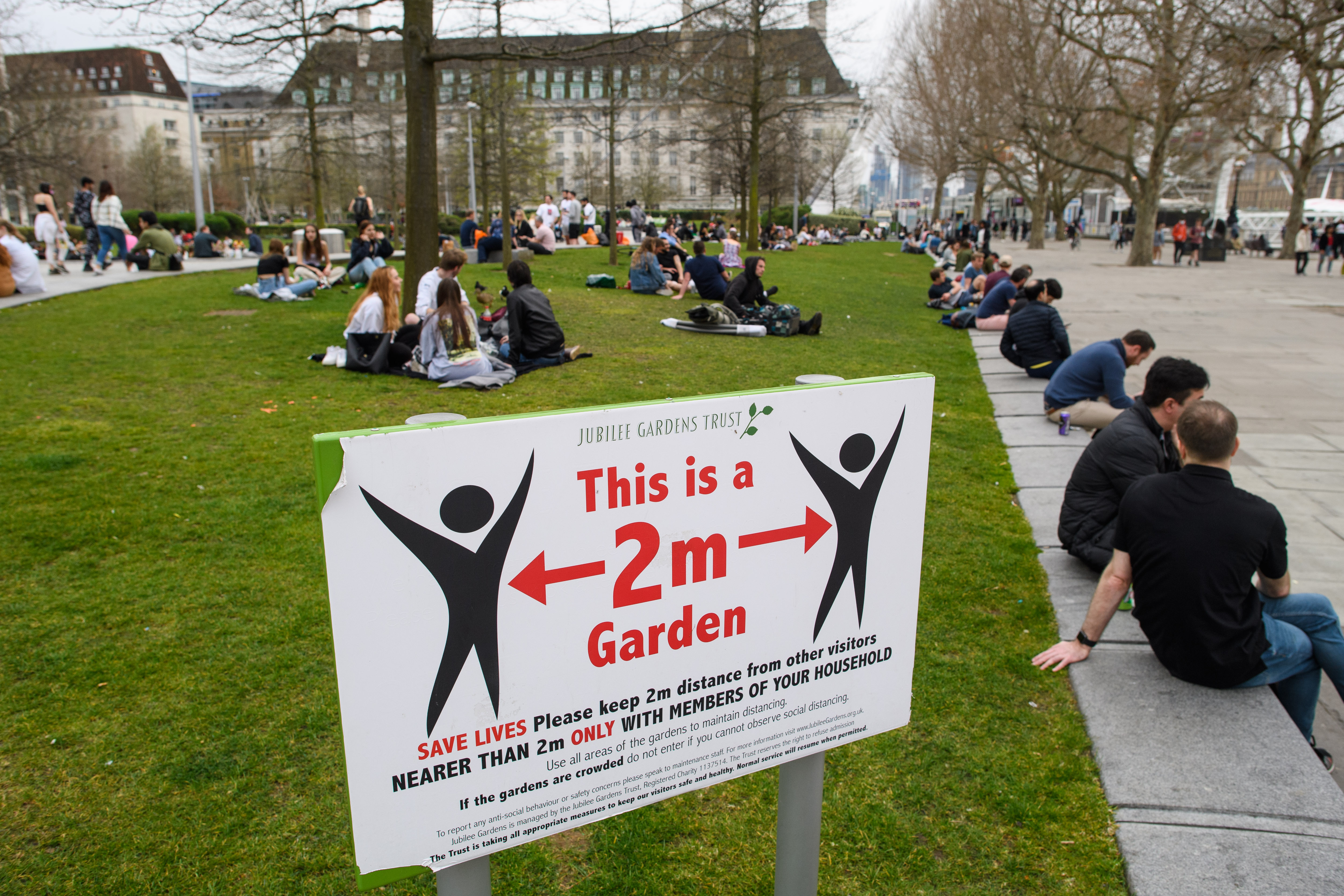 <p>Signs recommend social distancing on the South Bank in central London, as coronavirus lockdown restrictions are eased across the UK. Picture date: Wednesday March 31, 2021. Photo credit should read: Matt Crossick/Empics</p>