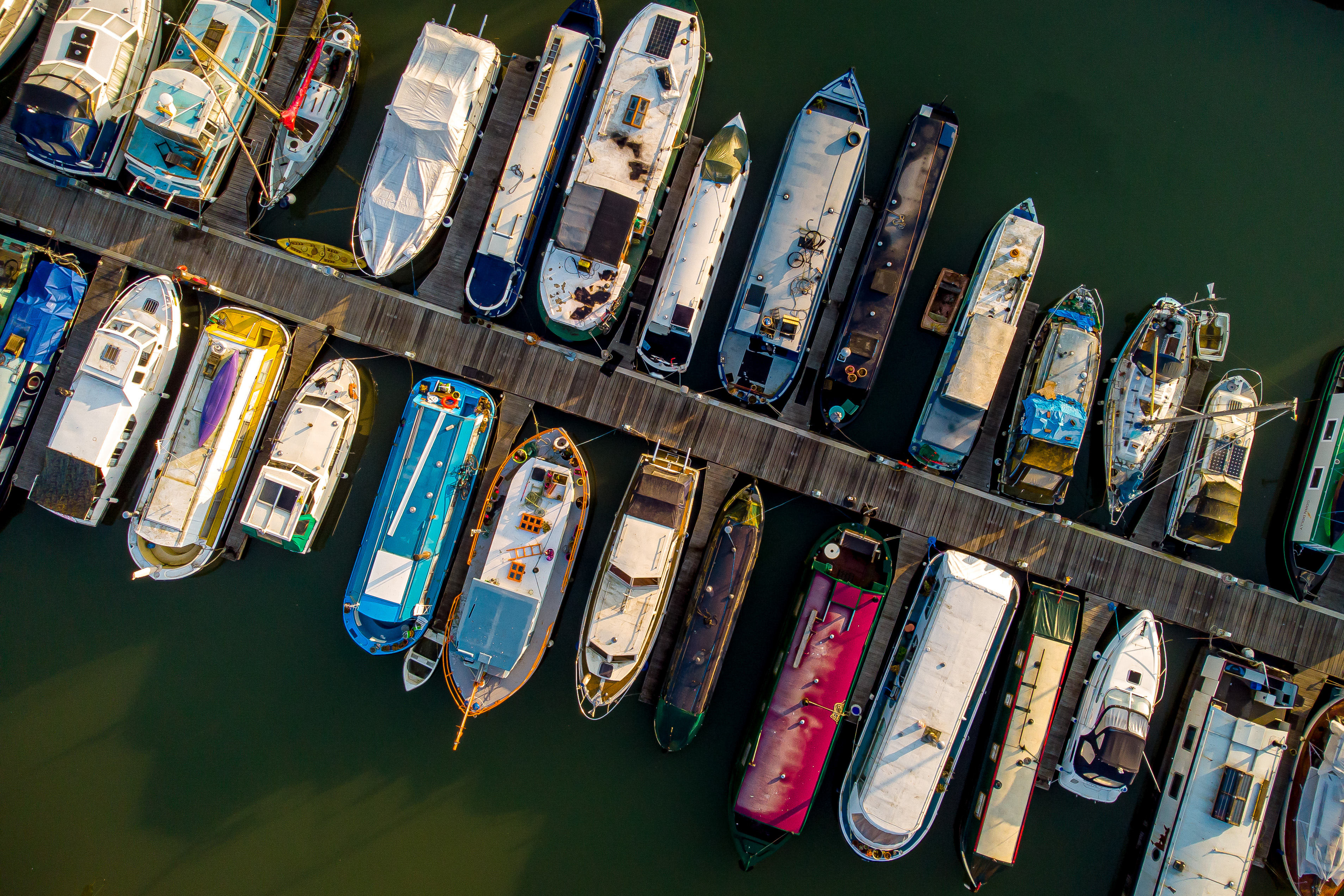<p>Boats moored on Bristol Harbourside on a calm and mild morning in the South West, where a Met Office weather warning for high winds across parts of the UK is in force until Thursday 11th March. Picture date: Tuesday March 9, 2021.</p>