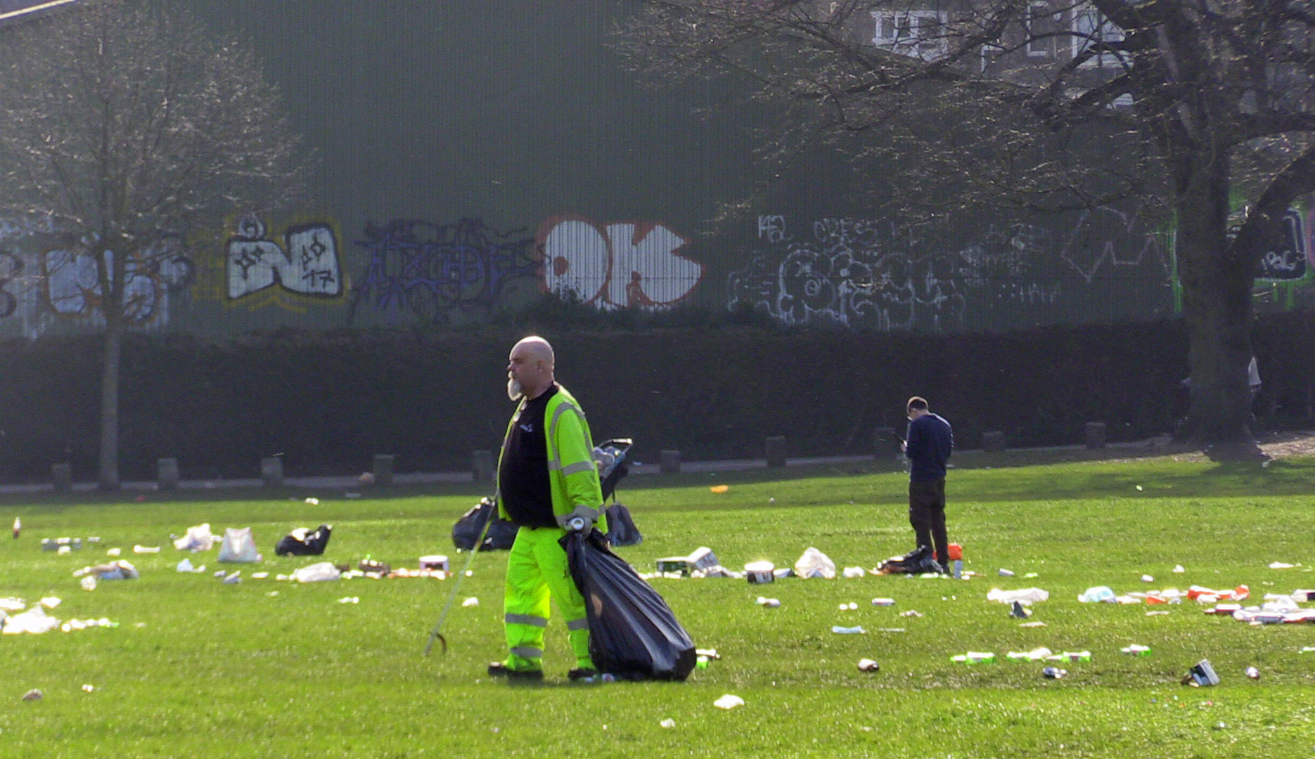 <p>People clearing up in Endcliffe Park, Sheffield, after yesterday's warm weather and the easing of England's lockdown restrictions saw groups of people congregating in parks, raising social distancing concerns. Picture date: Wednesday March 31, 2021.</p>