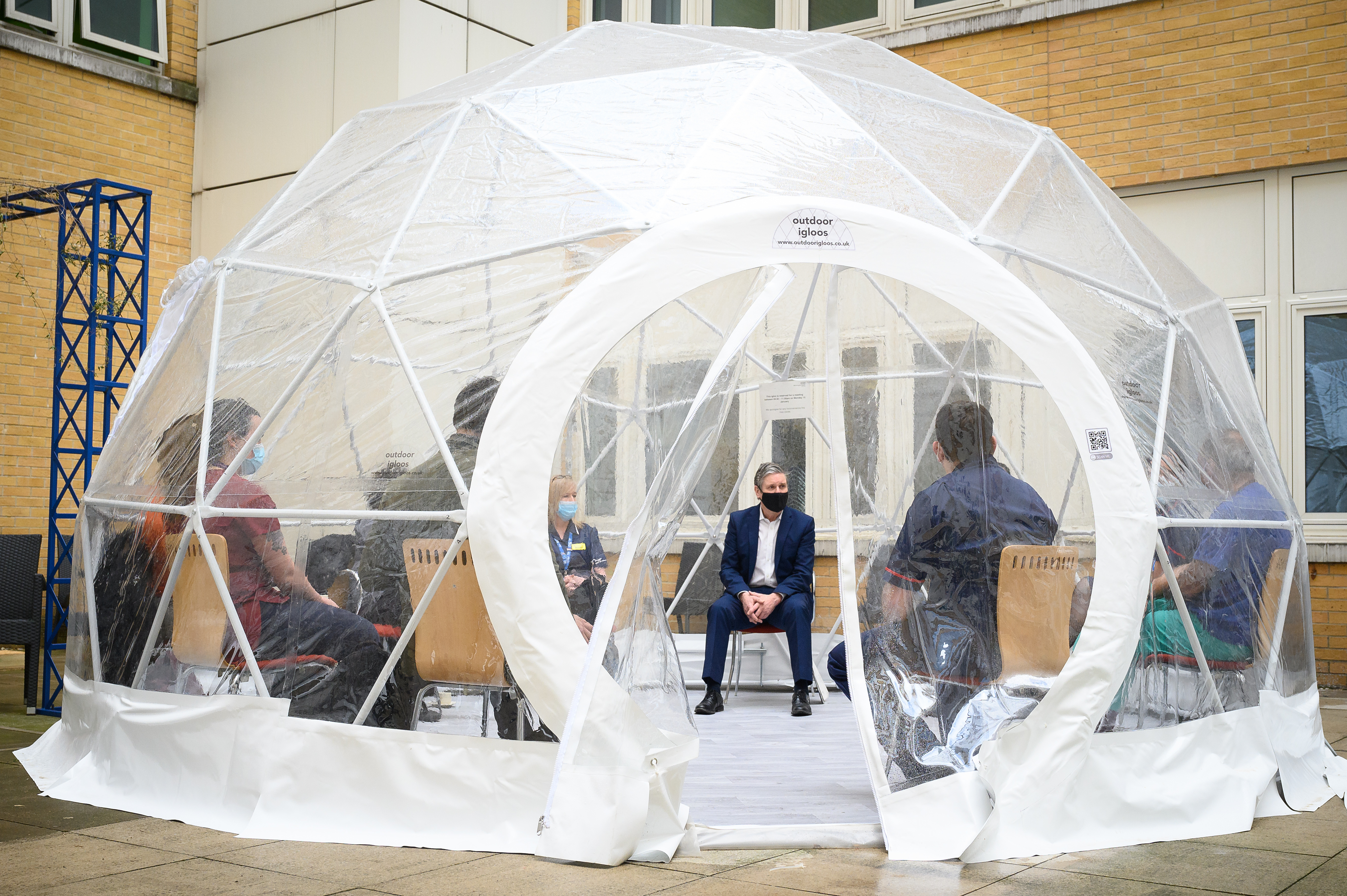 <p>LONDON, ENGLAND - MARCH 15: Labour Party leader Keir Starmer speaks with nurses and midwives inside a pop-up dome during a visit to the Whittington hospital on March 15, 2021 in London, England. The Labour Party has proposed a pay increase of at least 2.1%, following the Governments decision to offer a capped 1% pay rise to NHS workers, which critics have stated is an real terms pay cut when interest rates are considered. (Photo by Leon Neal/Getty Images)</p>