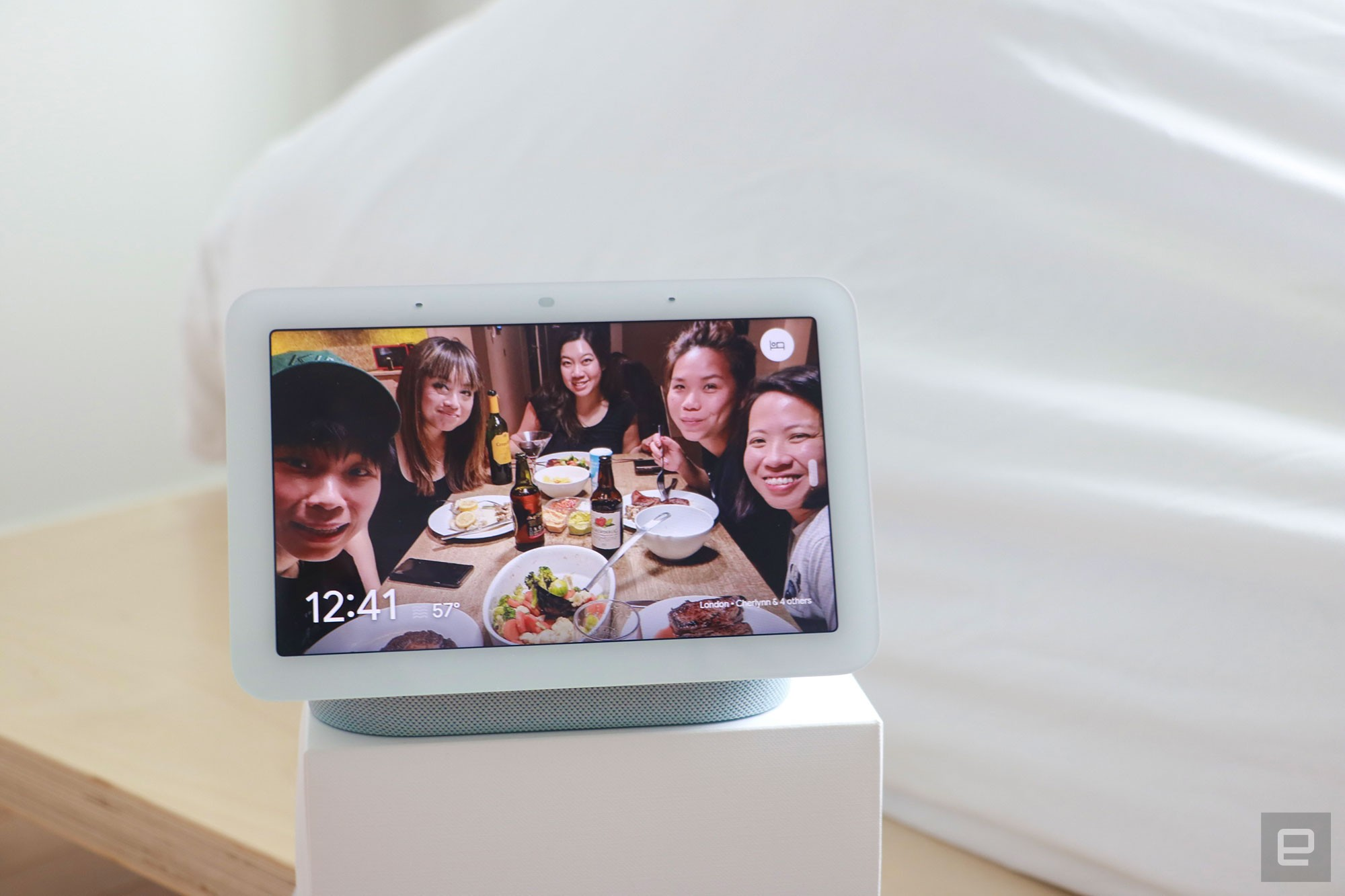 <p>Google Nest Hub 2021 (2nd gen) photo. Picture of Google's newest smart display on a box next to a bed.</p>