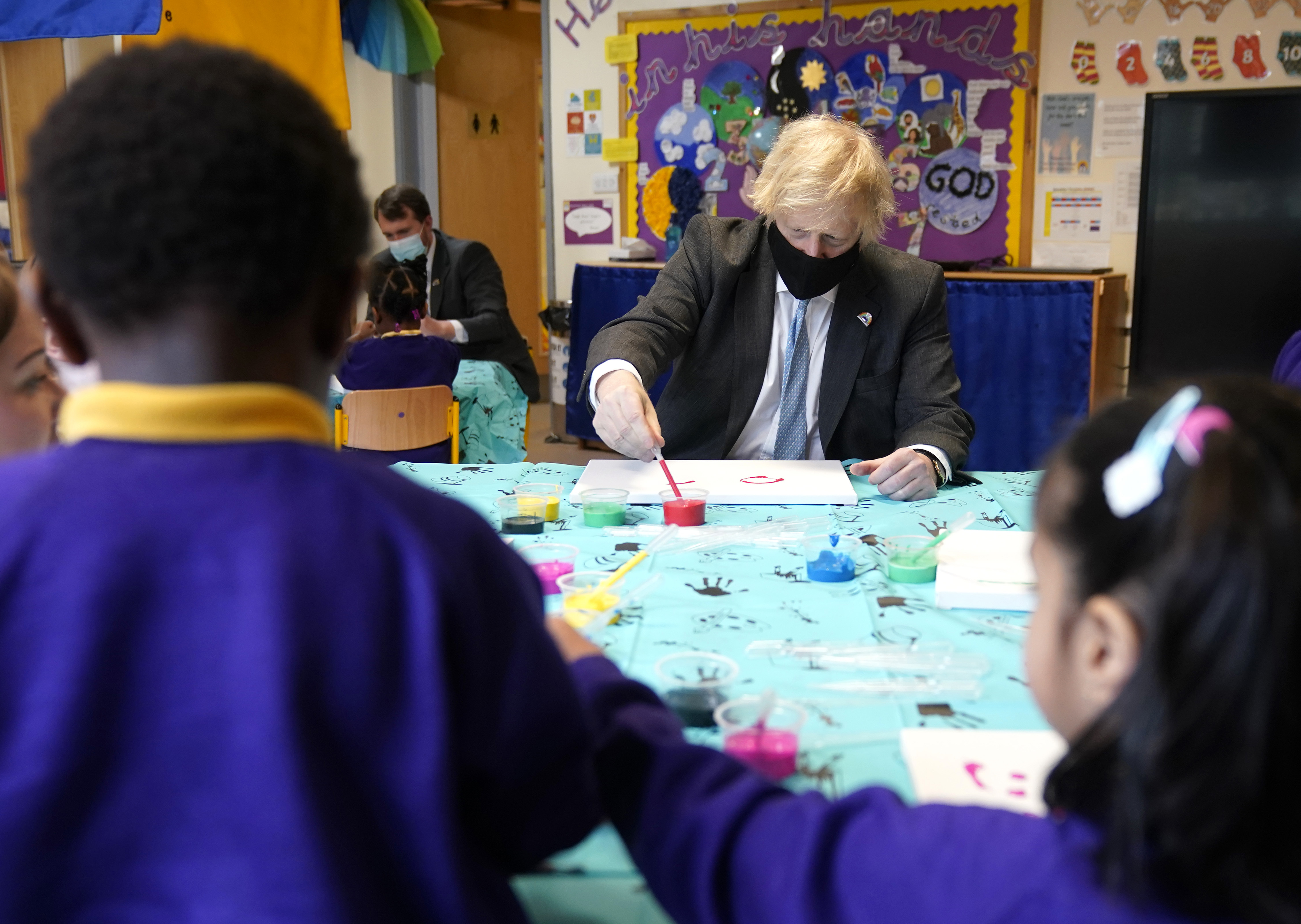 <p>Britain's Prime Minister Boris Johnson joins a reception art class painting lesson during a visit to St Mary's Primary School at Stoke-on-Trent, England, Monday March 1, 2021.  The children of key workers are at school already, but schools will fully reopen starting March 8, after months of closure due to concerns about COVID-19. (Christopher Furlong/pool via AP)</p>