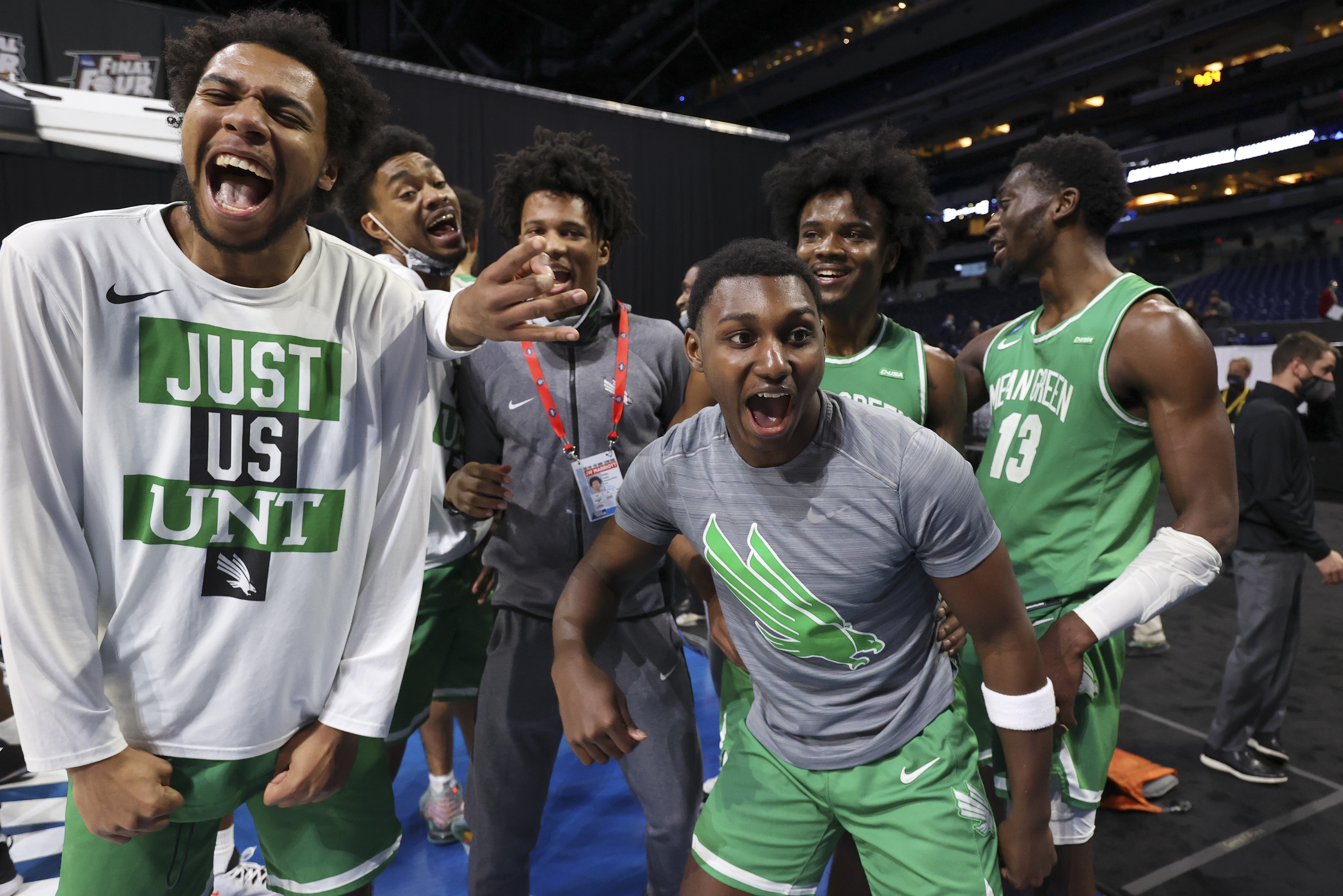 INDIANAPOLIS, IN - MARCH 19: The North Texas Mean Green celebrate their victory over the Purdue Boilermakers in the first round of the 2021 NCAA Division I Mens Basketball Tournament held at Lucas Oil Stadium on March 19, 2021 in Indianapolis, Indiana. (Photo by Jamie Schwaberow/NCAA Photos via Getty Images)