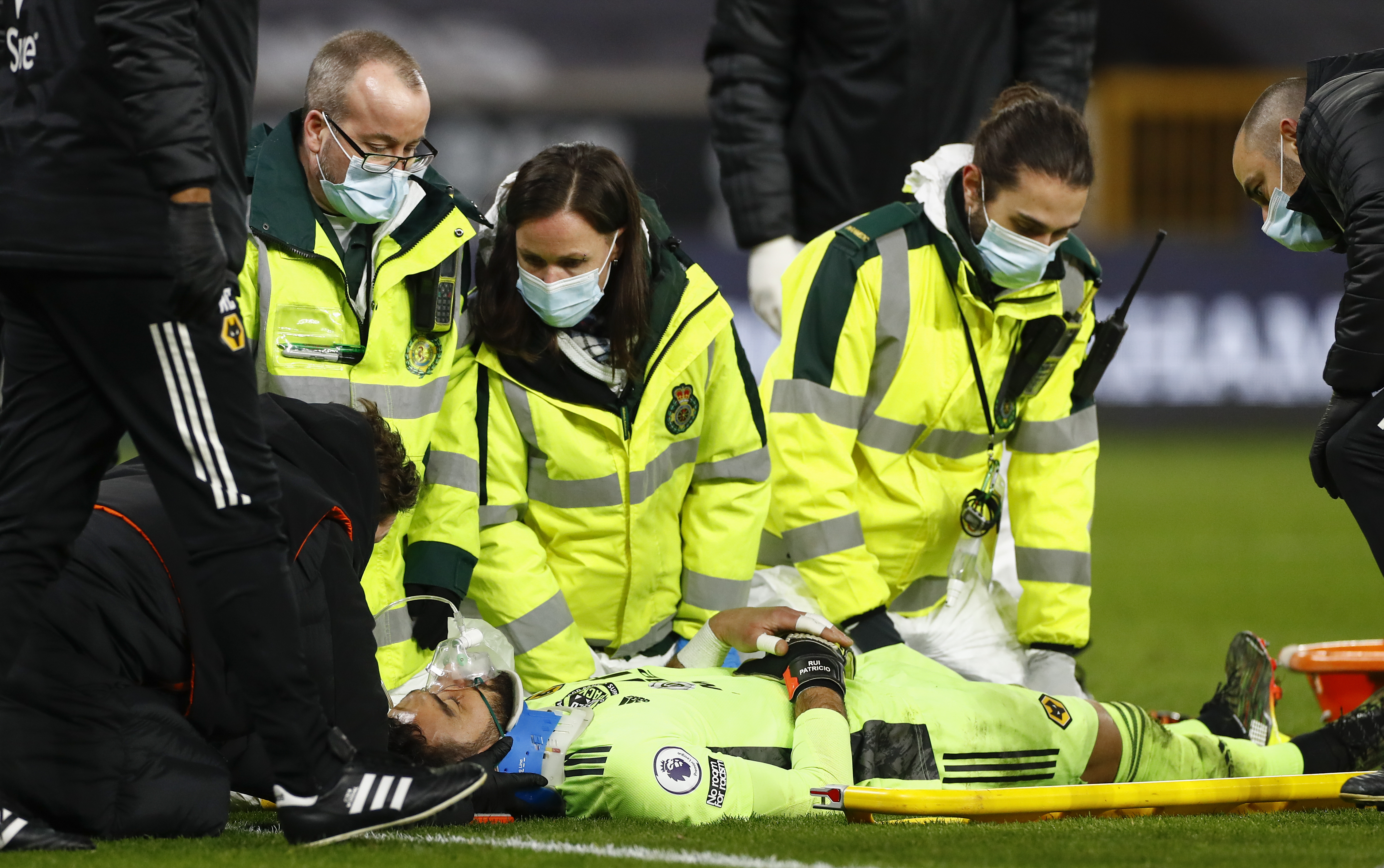 <p>Medical staff attend to Wolverhampton Wanderers' goalkeeper Rui Patricio during the English Premier League soccer match between Wolverhampton Wanderers and Liverpool at Molineux Stadium in Wolverhampton, England, Monday, March. 15, 2021. (AP Photo/Jason Cairnduff,Pool)</p>
