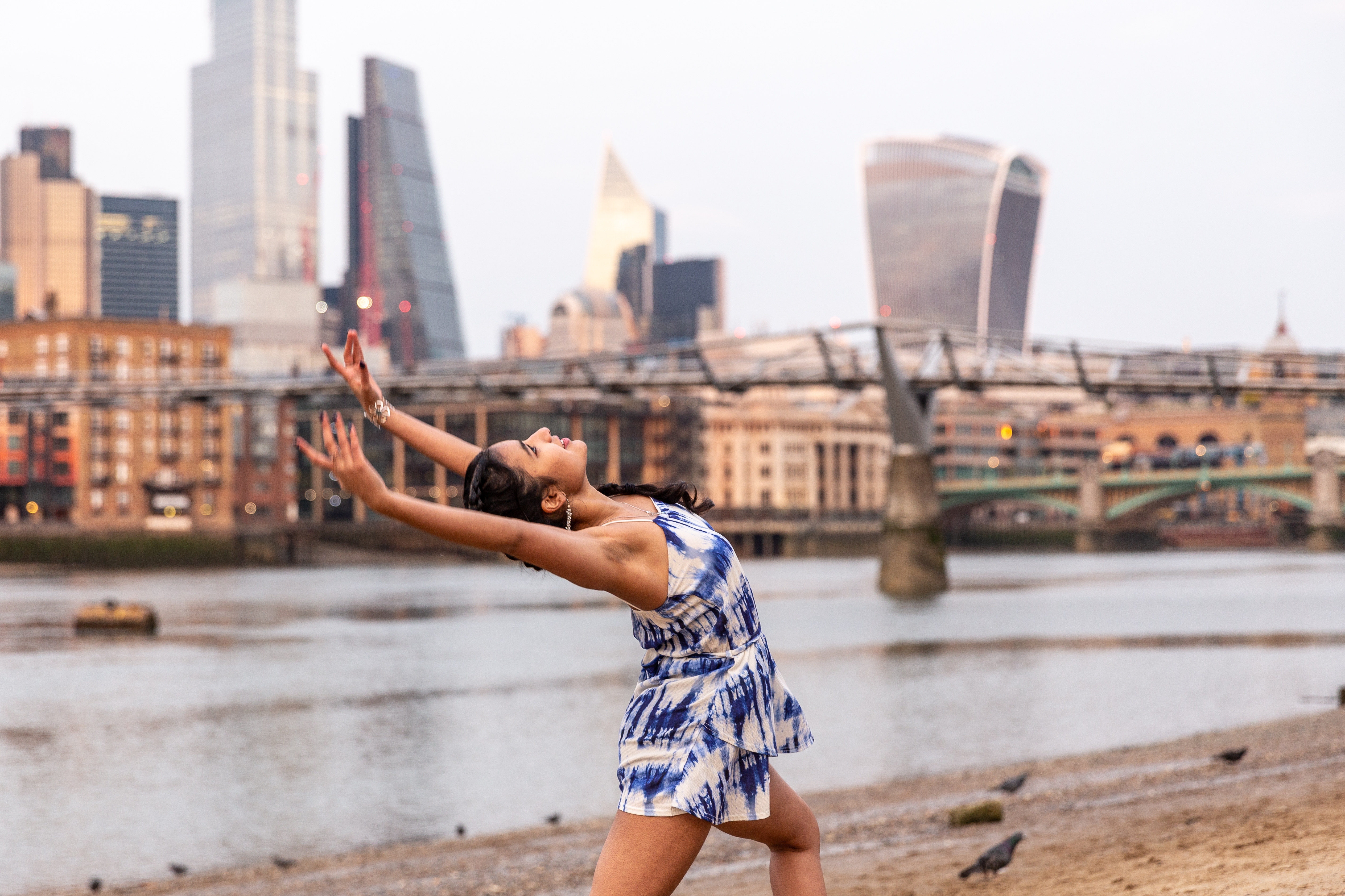 <p>London, England on March 8, 2021. Young woman practices dance routine on a sandy beach in Southbank by the Thames river while the setting sun covers The City of London, the financial hub of the UK during an ongoing�third Coronavirus lockdown. The Prime Minister Boris Johnson have set a road map on easing the restrictions. (Photo by Dominika Zarzycka/Sipa USA)</p>