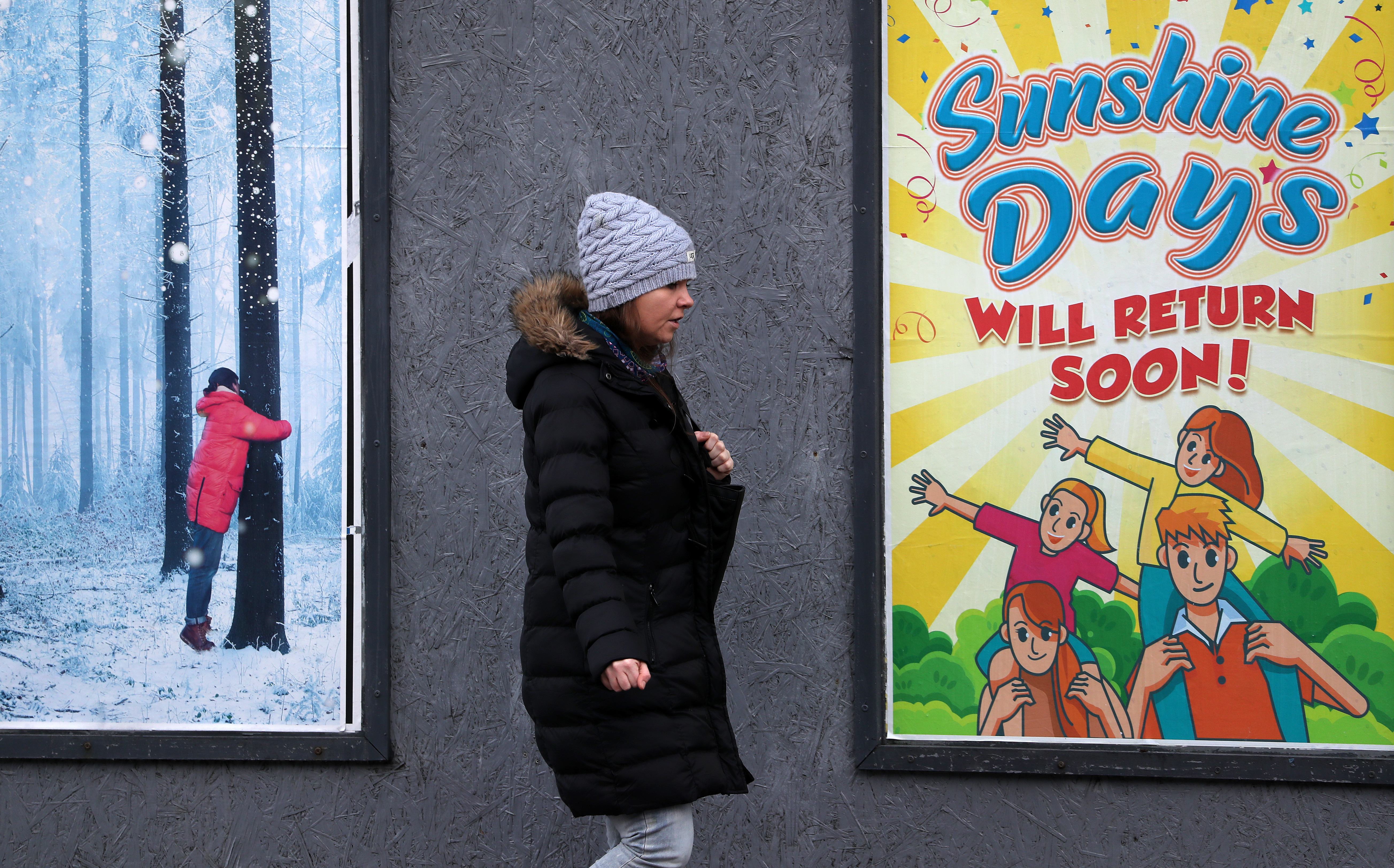 <p>A person walks passed an advertising board in Glasgow showing an advert from the Pavilion Theatre, as lockdown measures for mainland Scotland continue. Picture date: Friday March 12, 2021.</p>
