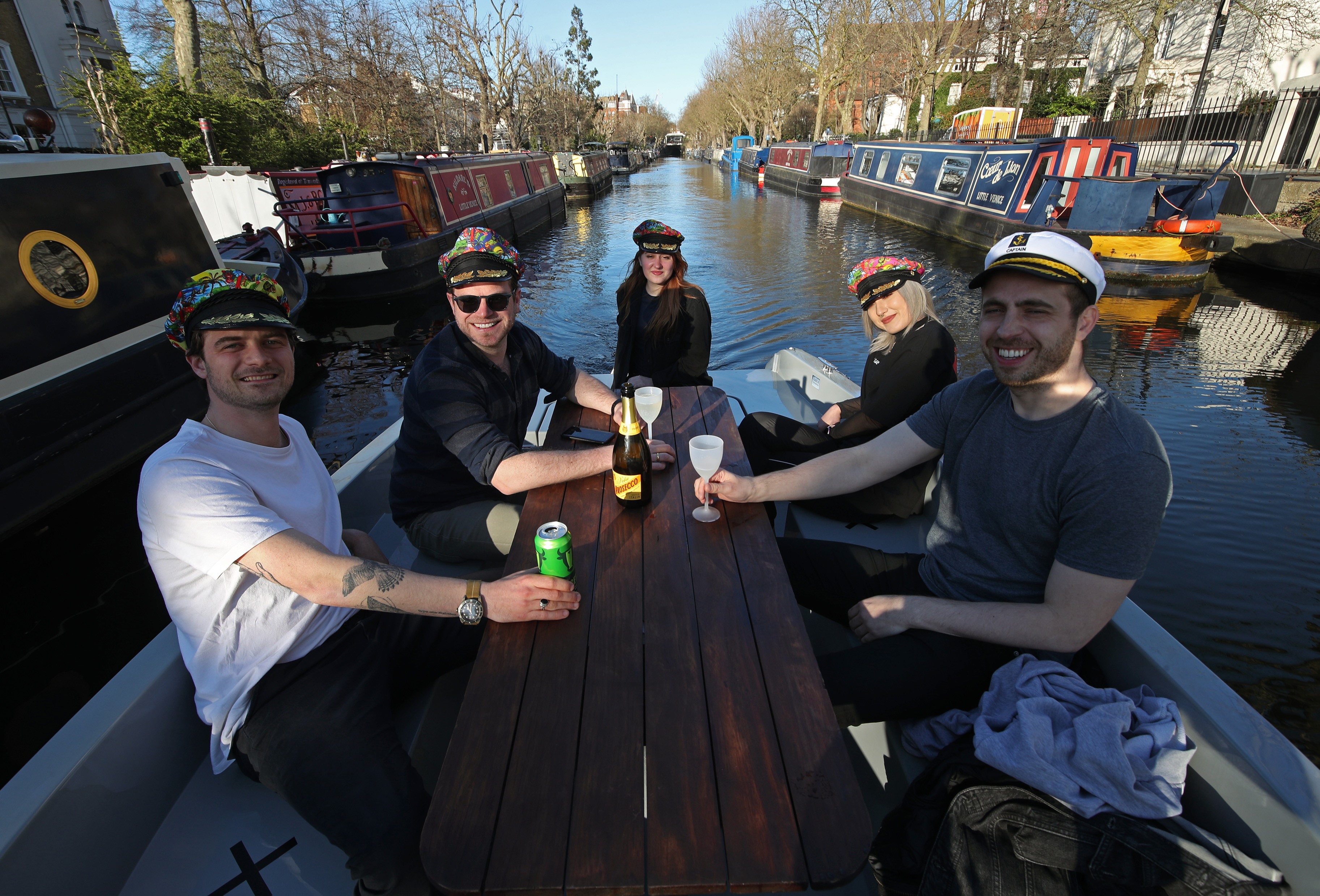 <p>Guests cruising along the Grand Union Canal, London, in a GoBoat, as the boat-hire company has reopened for business following the easing of England's lockdown to allow far greater freedom outdoors. Picture date: Monday March 29, 2021.</p>