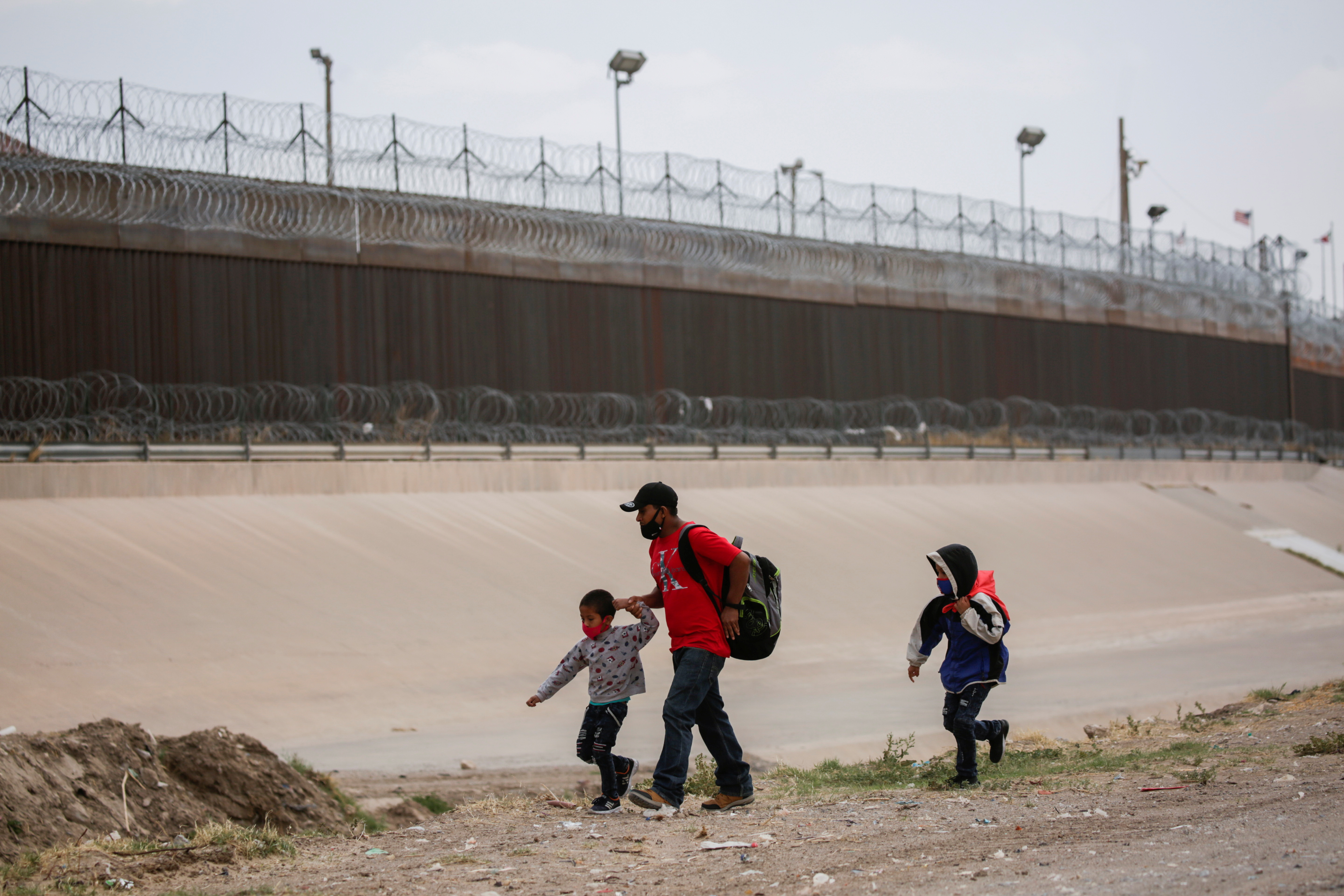 Migrants are seen in Ciudad Juarez, Mexico before crossing the Rio Bravo river to turn themselves in to U.S. Border Patrol agents to request for asylum in El Paso, Texas on March 22, 2021. (Jose Luis Gonzalez/Reuters)