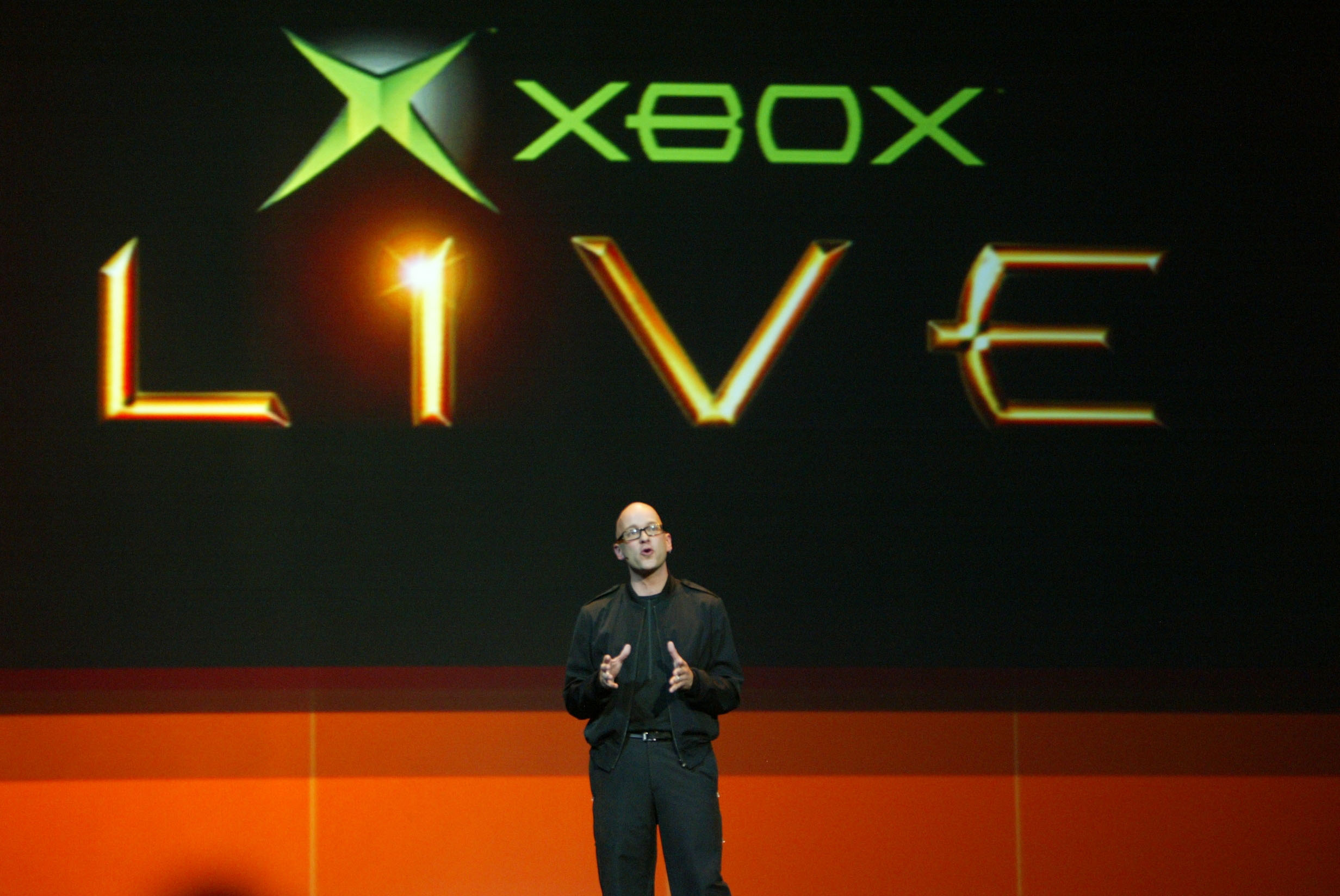 Microsoft Xbox chief XNA architect J Allard announces plans for content for Xbox Live, the online gaming component of Microsoft's Xbox, during a press preview of Microsoft Xbox gaming system in Los Angeles, May 10, 2004. The Electronic Entertainment Expo, a trade show for the video game industry, opens in Los Angeles May 12, 2004. Many companies will be introducing new hardware and software titles for fans of video games. REUTERS/Fred Prouser  FSP/DL