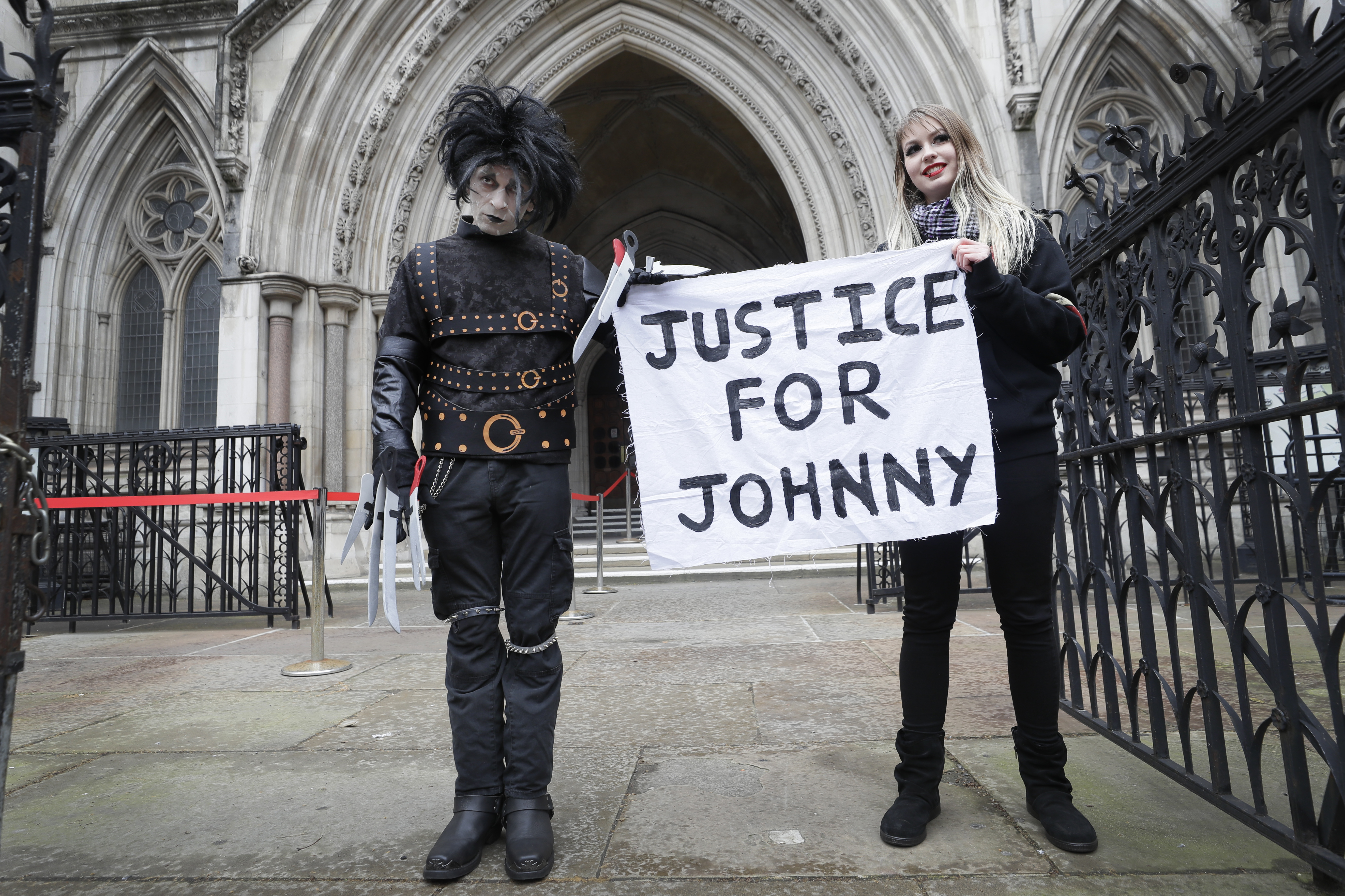 <p>Johnny Depp supporters hold a banner outside the High Court in London, Thursday, March 18, 2021. Johnny Depp's bid to overturn a damning ruling that he assaulted his ex-wife Amber Heard and put her in fear for her life will be considered by the Court of Appeal on Thursday.(AP Photo/Kirsty Wigglesworth)</p>