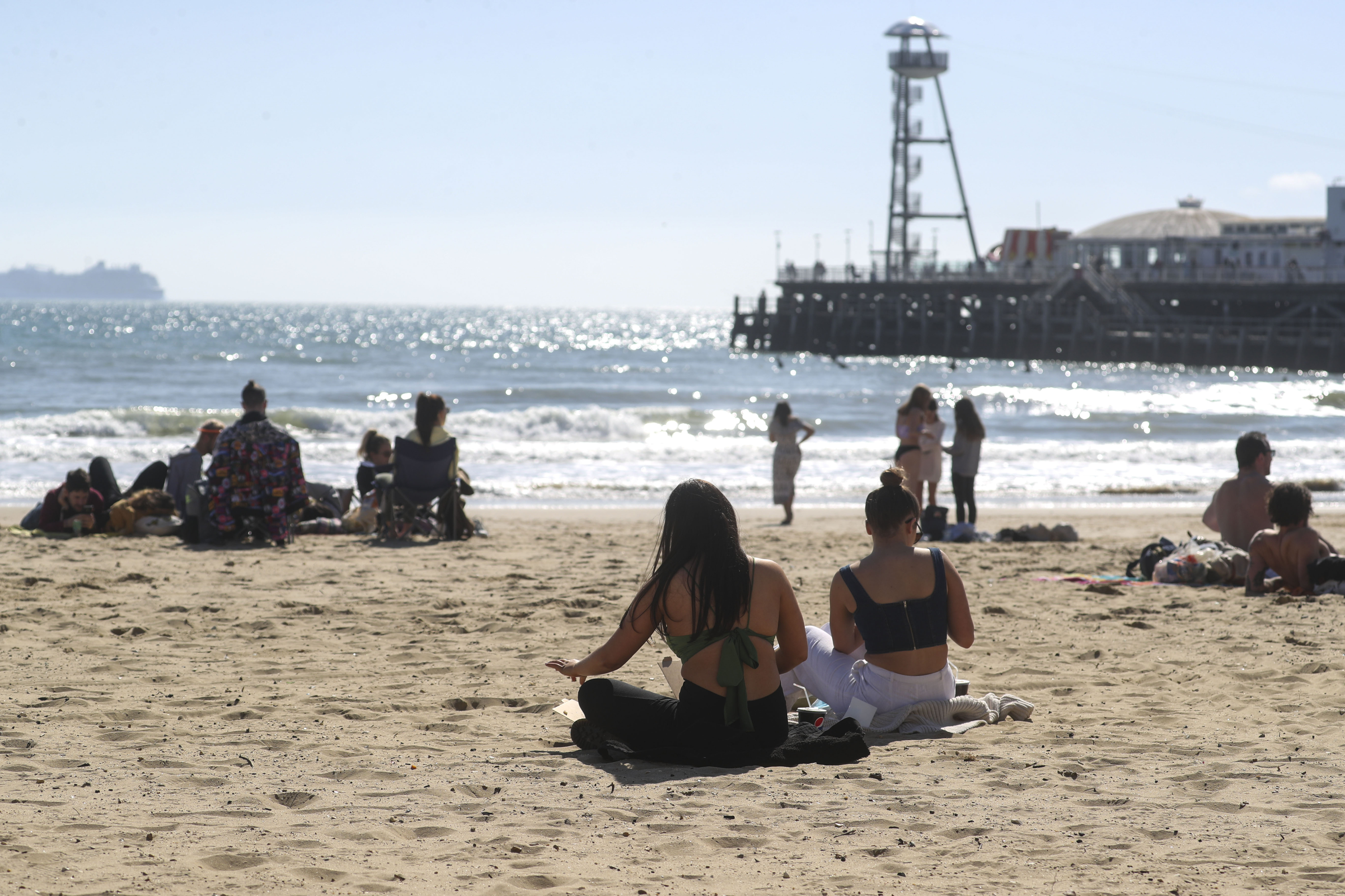 <p>People sit on Bournemouth beach following the easing of England's lockdown to allow far greater freedom outdoors. Picture date: Monday March 29, 2021.</p>