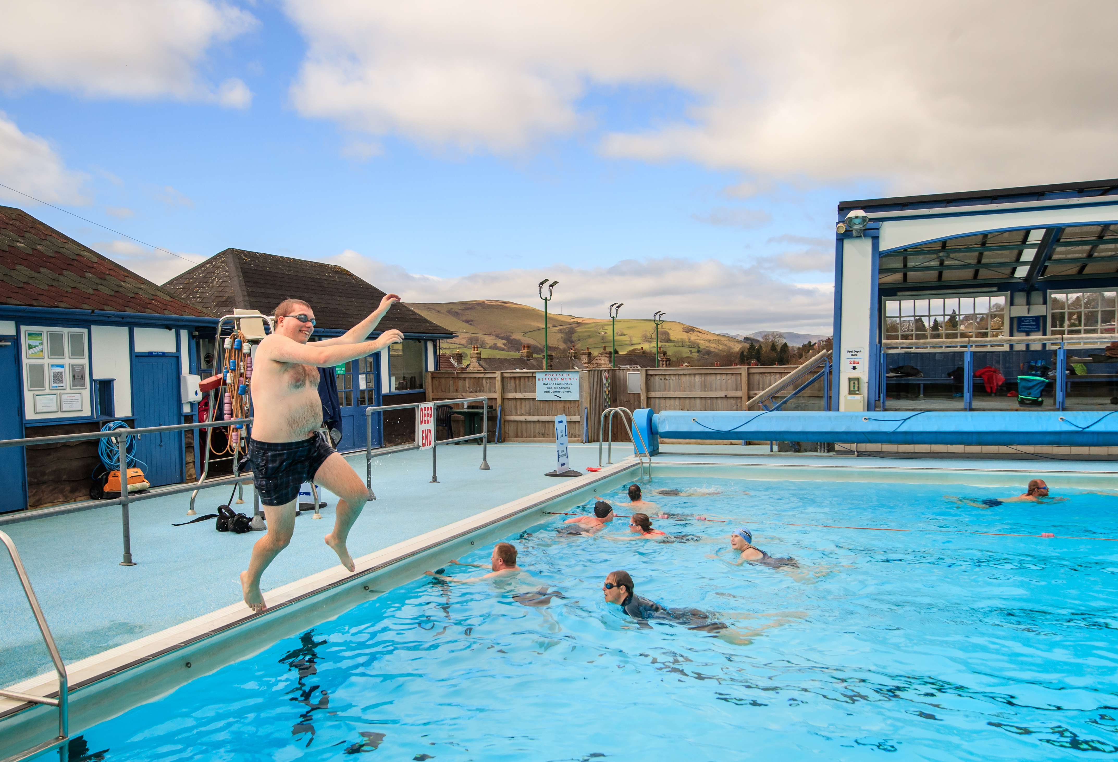 <p>A man jumps in the pool at Hathersage outdoor swimming pool near Hope Valley, following the easing of England's lockdown to allow far greater freedom outdoors. Picture date: Monday March 29, 2021.</p>