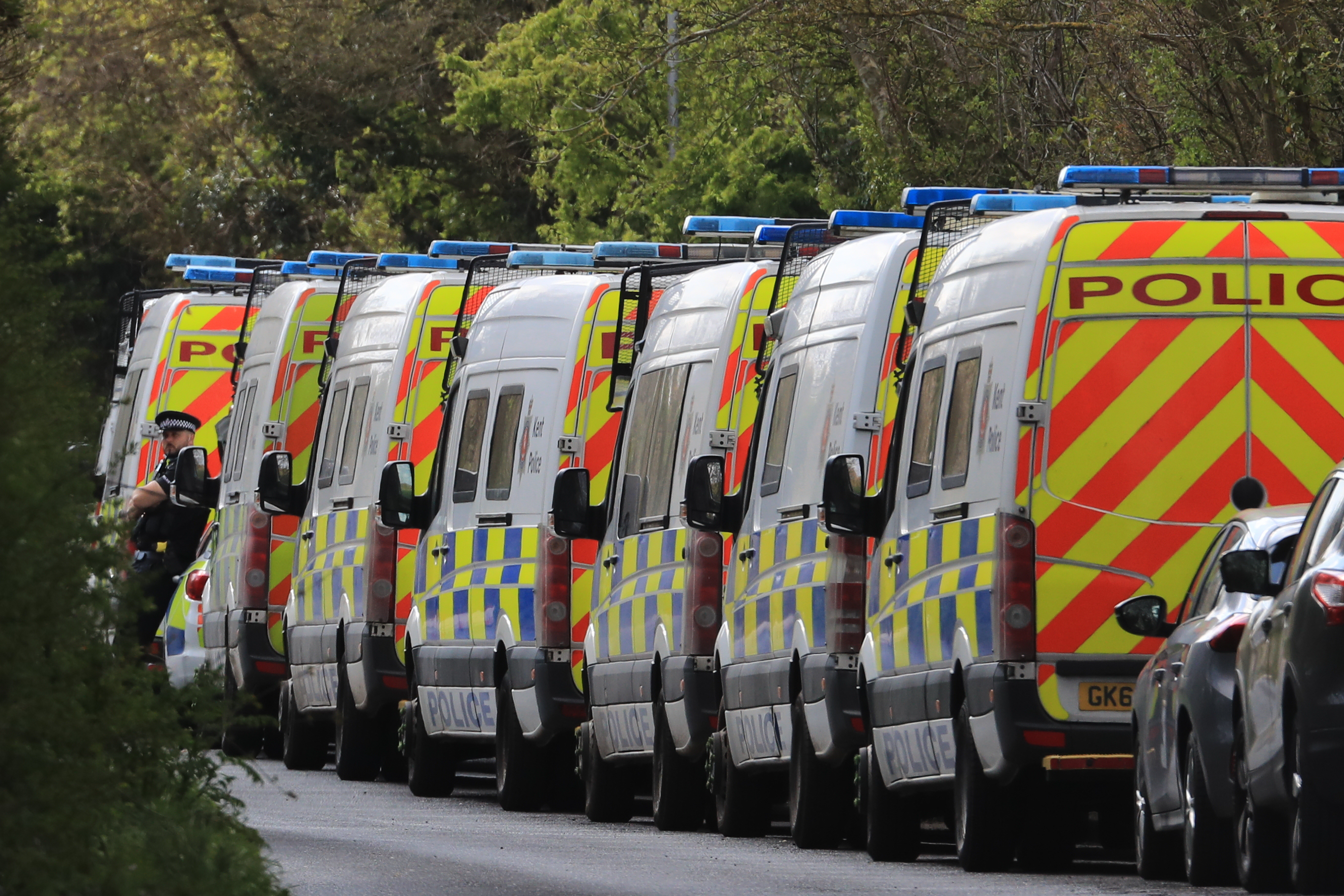 <p>Police vehicles near to the scene in Snowdown, Kent, where the body of PCSO Julia James was found. Kent Police have launched a murder enquiry following the discovery of the 53-year-old community support officer on Tuesday. Picture date: Thursday April 29, 2021.</p>