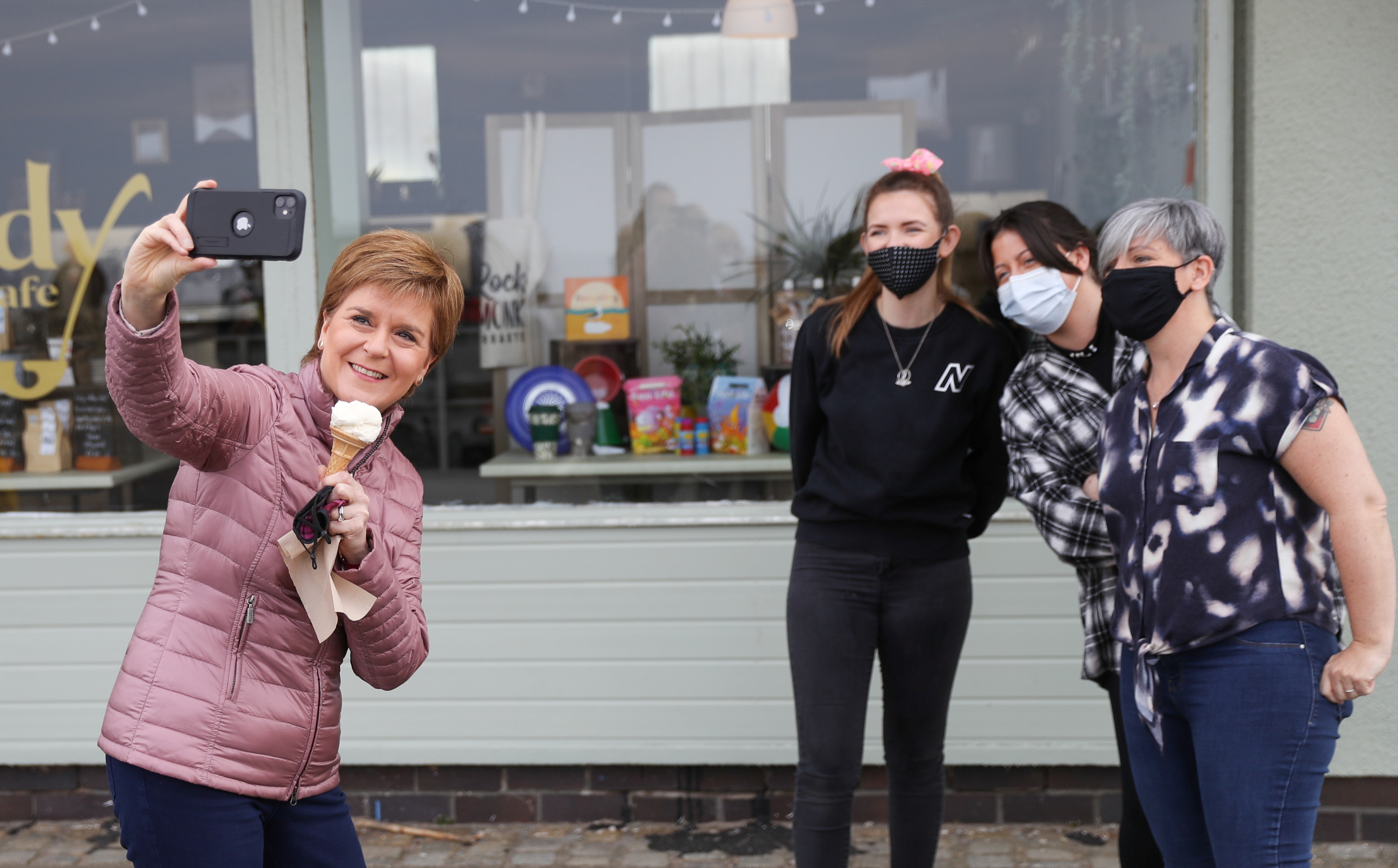 <p>Scotland's First Minister Nicola Sturgeon, leader of the Scottish National Party (SNP) (left), takes a photograph with three women in Ayr, South Ayrshire, during campaigning for the Scottish Parliamentary election. Picture date: Monday April 19, 2021.</p>