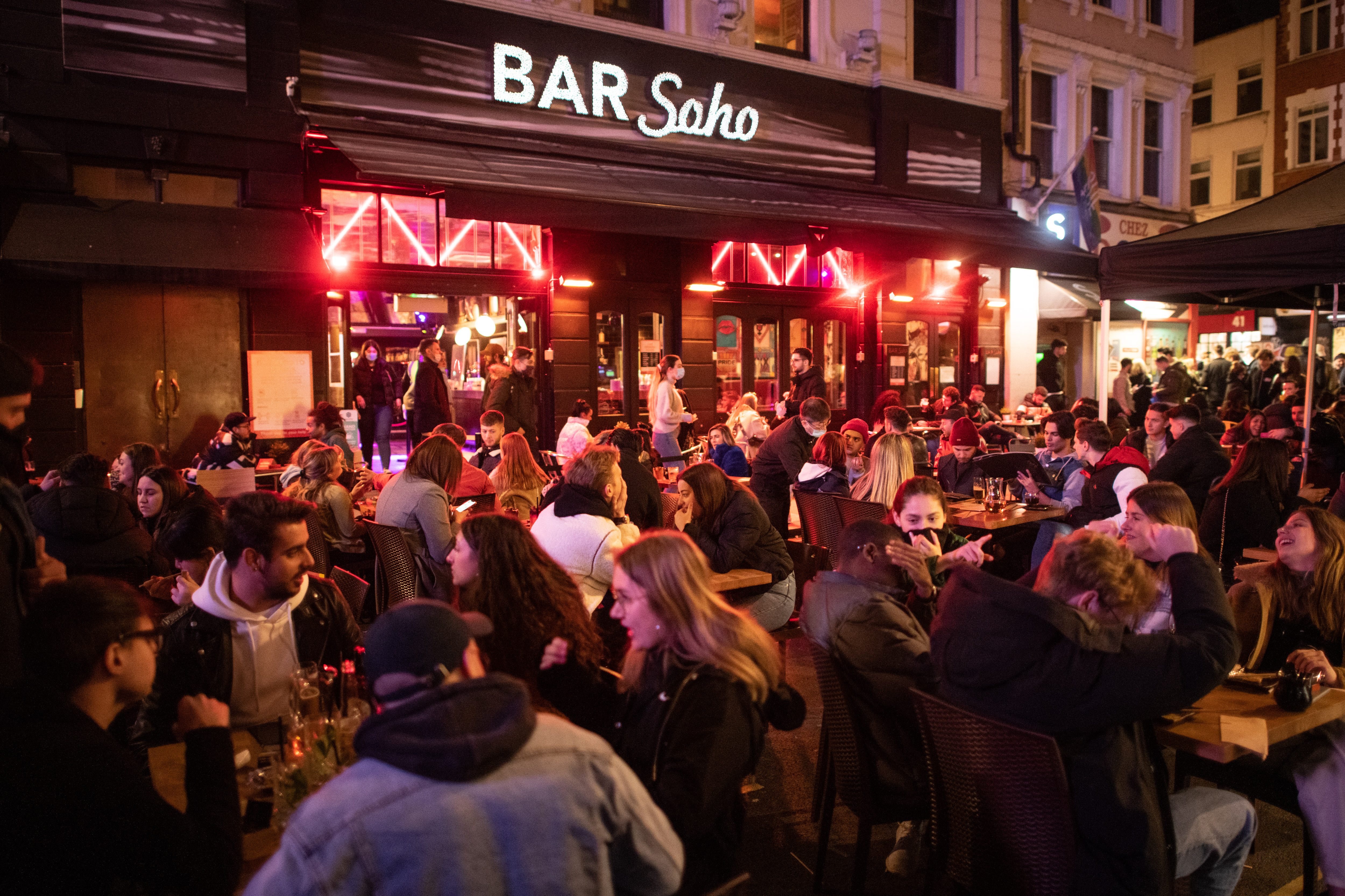 <p>People gather in Soho, London, where streets were closed to traffic as bars and restaurants opened for outside eating and drinking, as lockdown measures are eased across the UK. Picture date: Tuesday April 13, 2021. Photo credit should read: Matt Crossick/Empics</p>