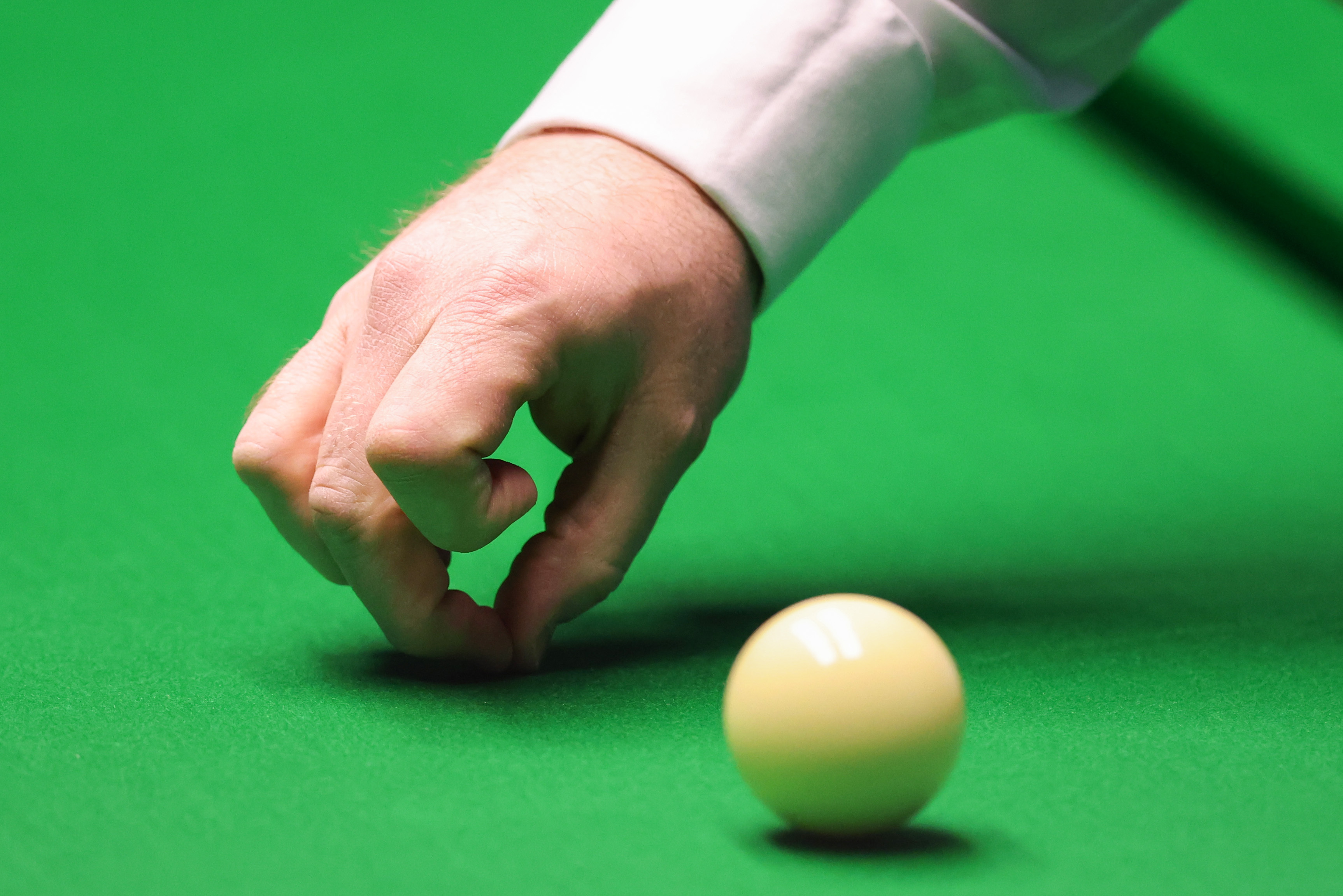 <p>Shaun Murphy checks the table during day five of the Betfred World Snooker Championships 2021 at The Crucible, Sheffield. Picture date: Wednesday April 21, 2021.</p>