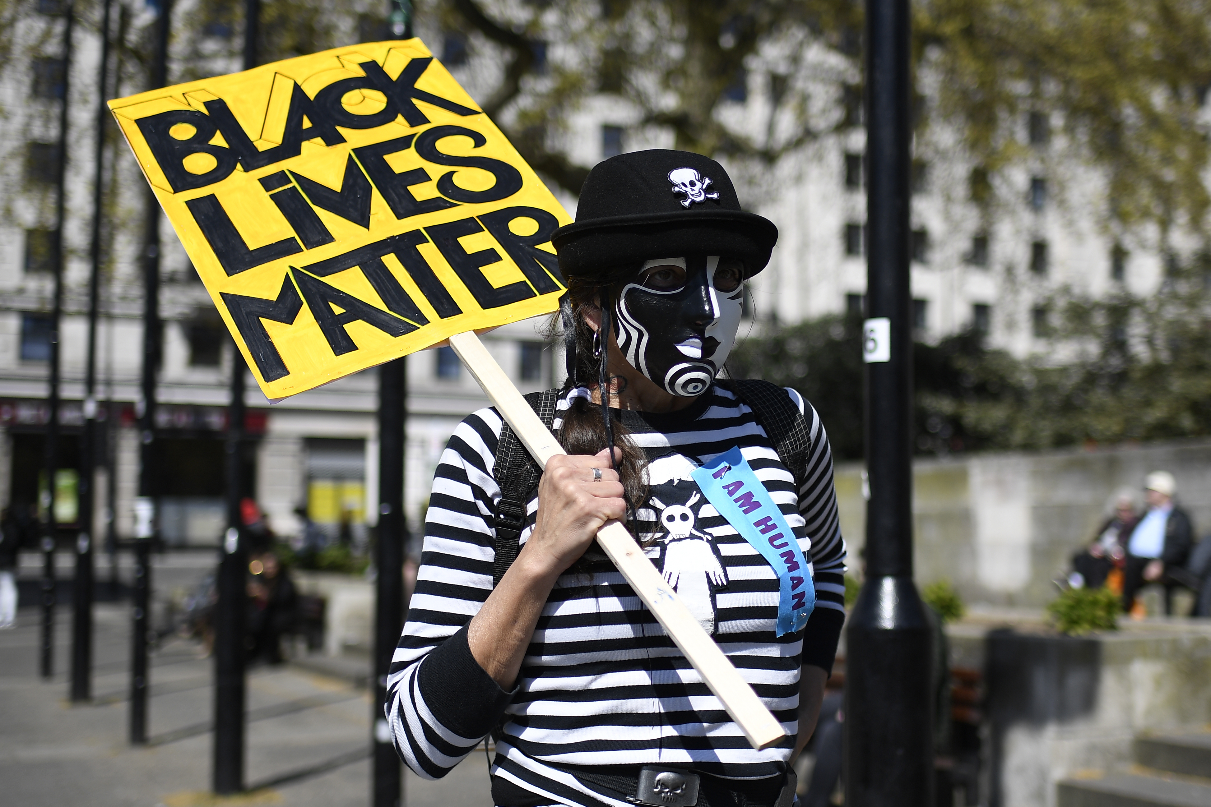 <p>A protester holds a banner during for 'Kill the Bill' protest in London, Sunday, April 25, 2021. The demonstration is against the contentious Police, Crime, Sentencing and Courts Bill, which is currently going through Parliament and would give police stronger powers to restrict protests. Some 'Black Lives Matter' protesters joined the rally. (AP Photo/Alberto Pezzali)</p>