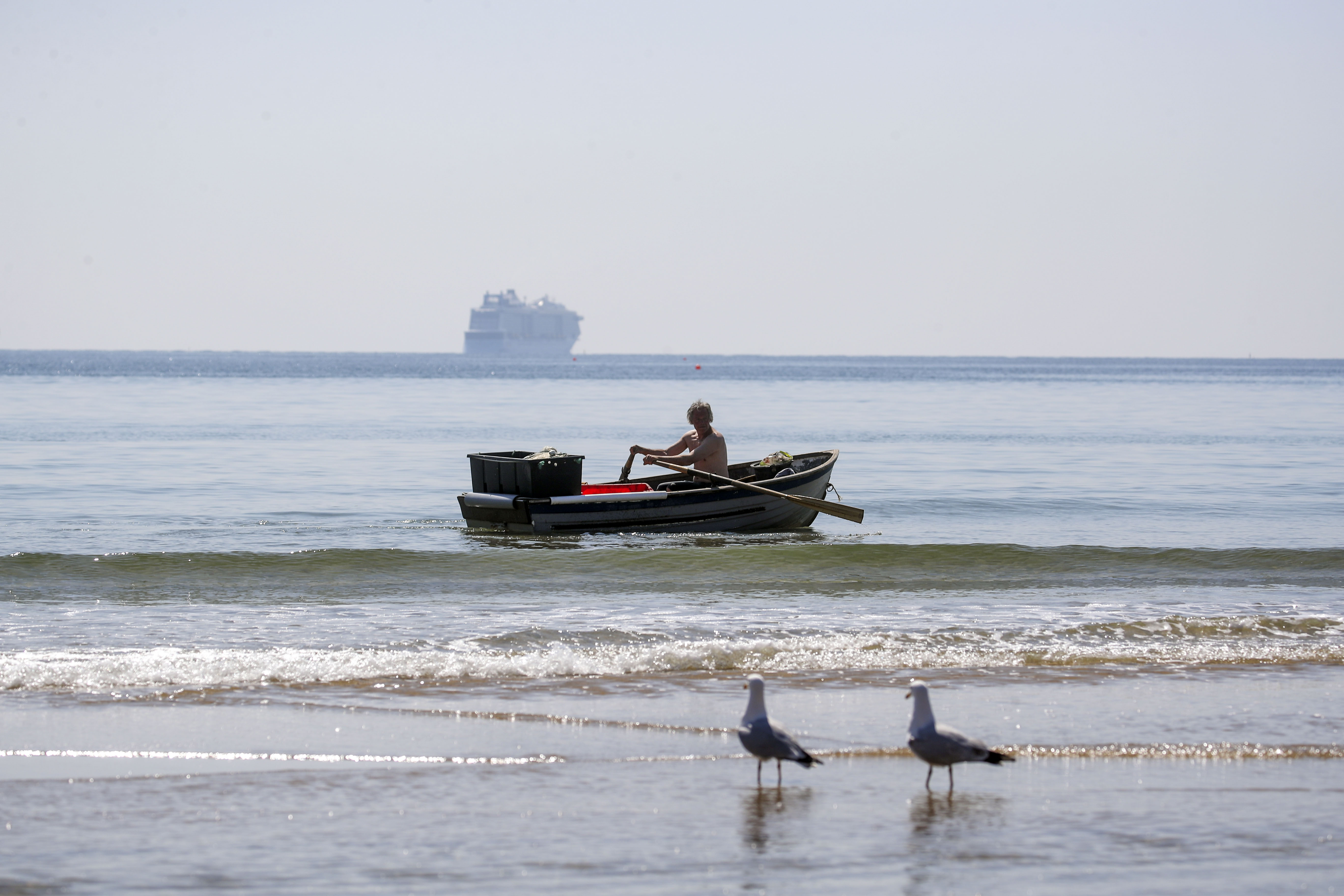 <p>A man rows a boat on the Solent in Bournemouth, Dorset. Picture date: Monday April 19, 2021.</p>