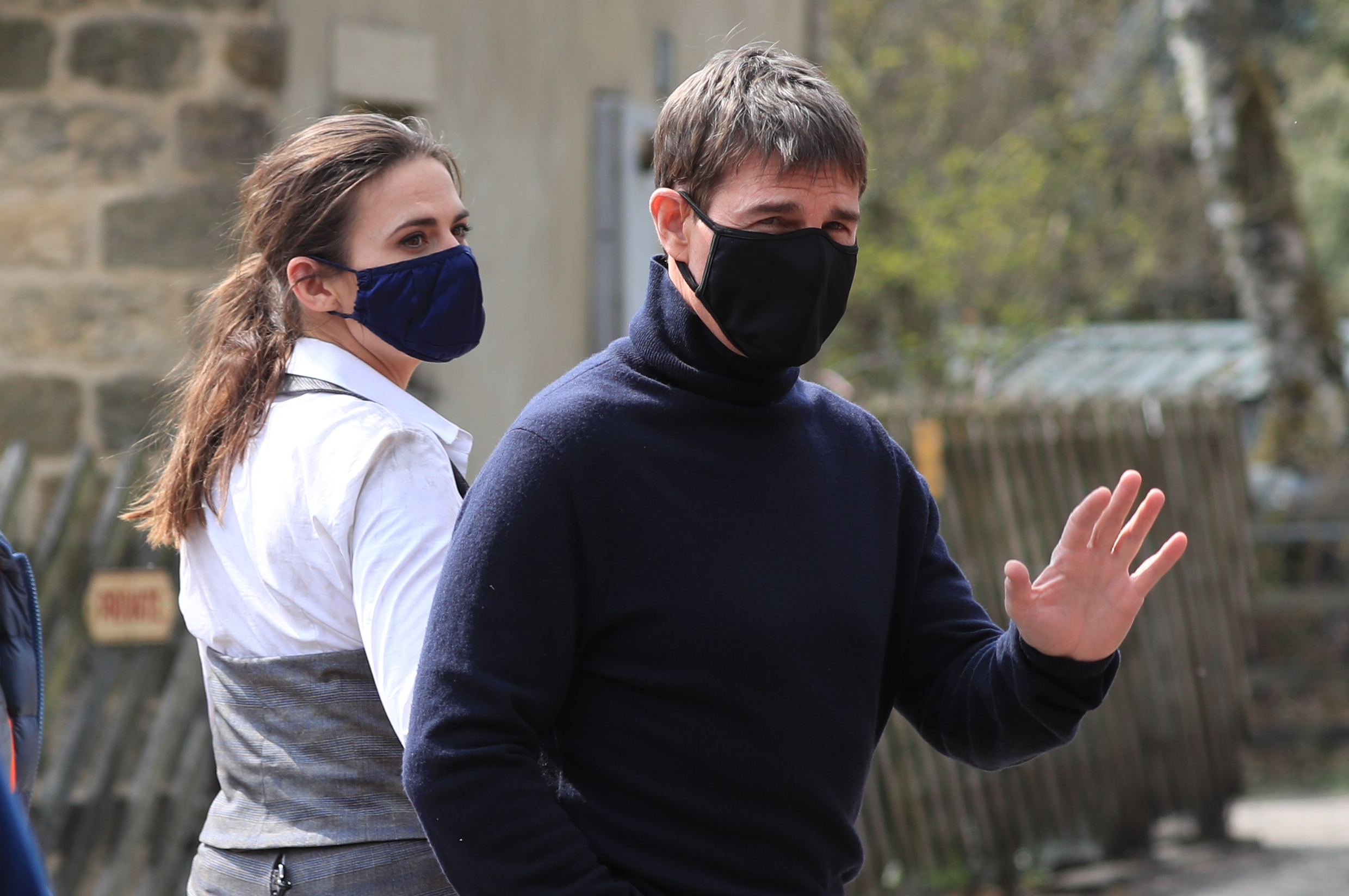 <p>Actor Tom Cruise waves to onlookers as he walks to the set of his latest project, which is filming in the sidings of the railway station in the village of Levisham in the North York Moors. Picture date: Tuesday April 20, 2021.</p>