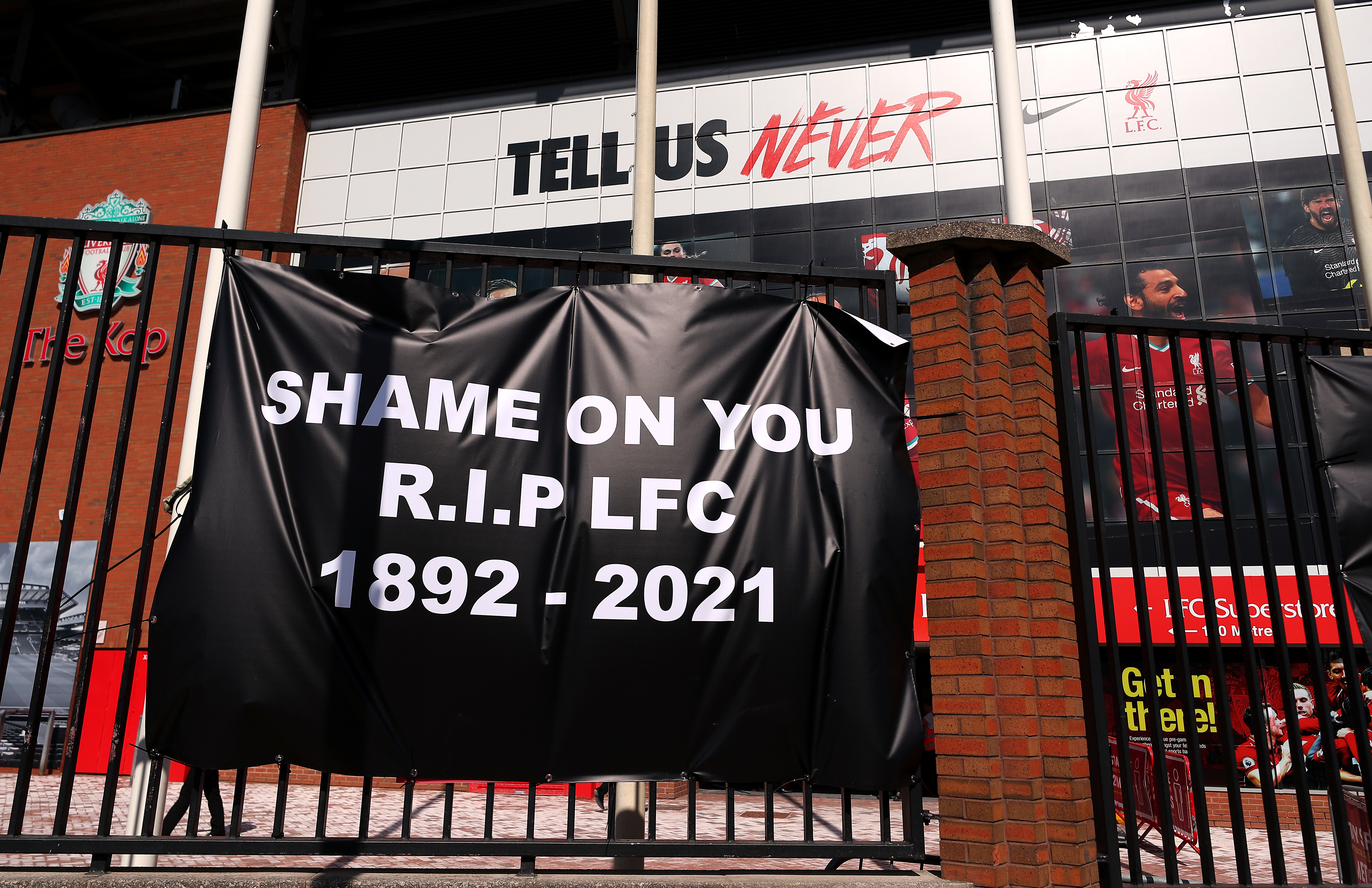 <p>Banners are placed outside of Anfield, home of Liverpool FC by fans to protest against its decision to be included amongst the clubs attempting to form a new European Super League. Picture date: Monday April 19, 2021.</p>