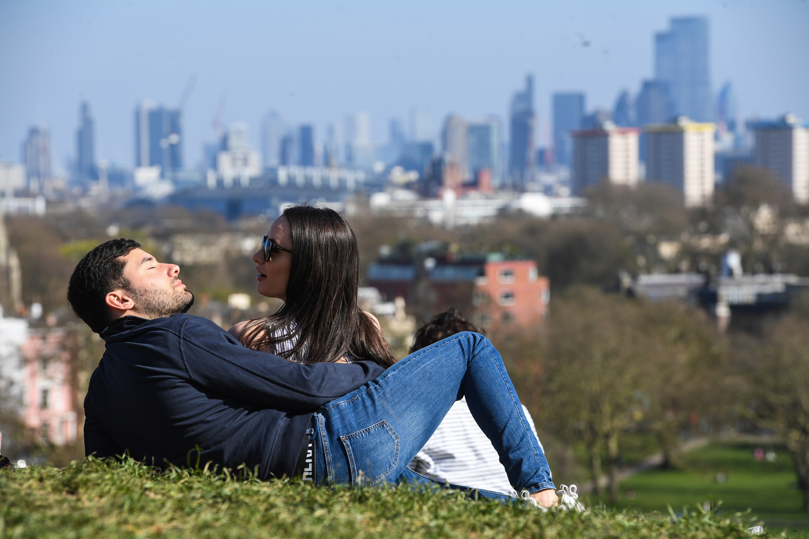 <p>People enjoy the sunshine on Primrose Hill in London. Picture date: Sunday April 4, 2021.</p>