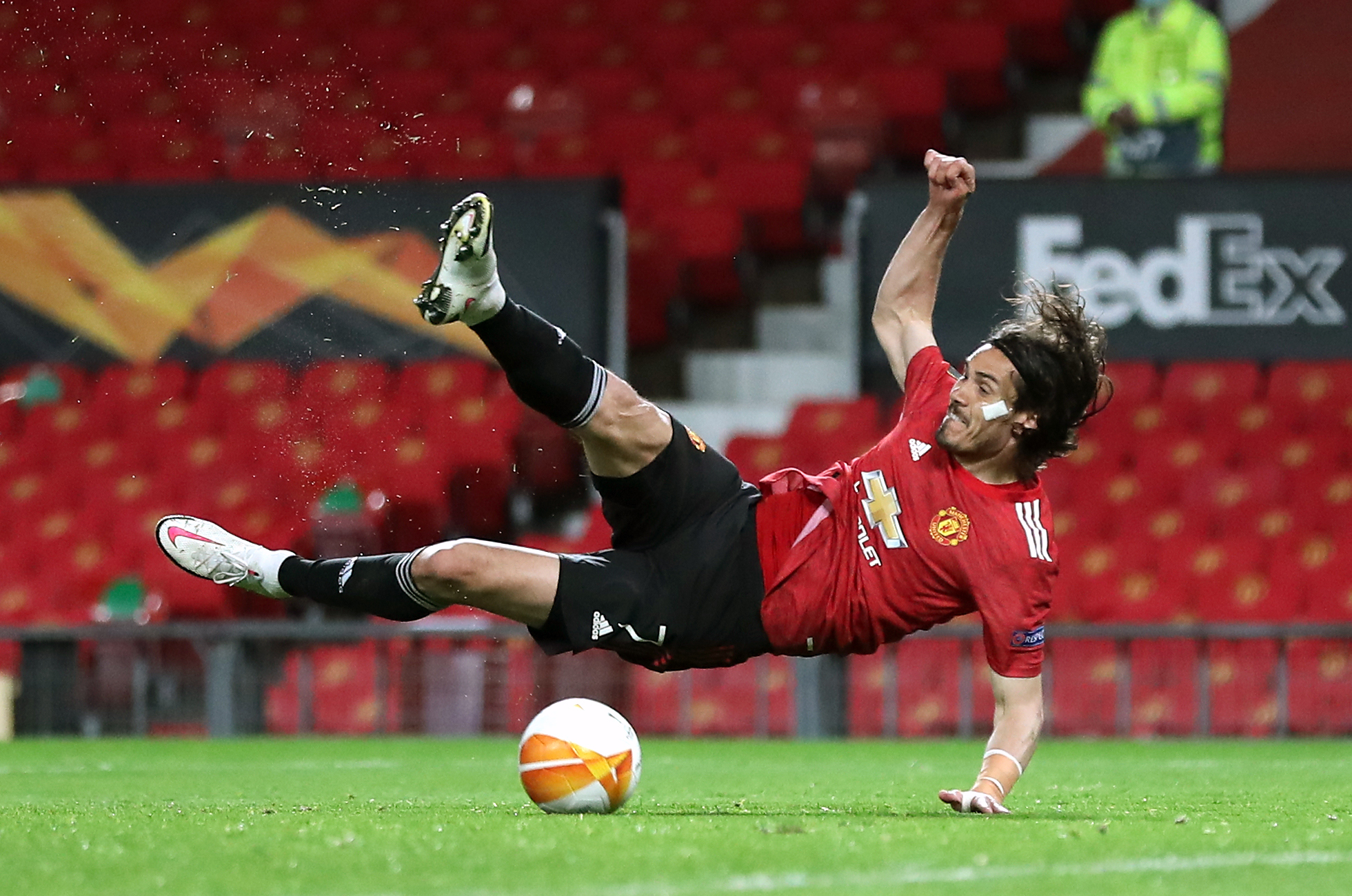 <p>Manchester United's Edinson Cavani trips and falls during the UEFA Europa League Semi Final First Leg match at Old Trafford, Manchester. Picture date: Thursday April 29, 2021.</p>