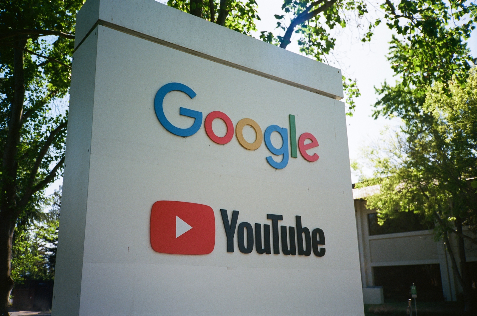 Sign with logos for Google and the Google owned video streaming service YouTube at the Googleplex, the Silicon Valley headquarters of search engine and technology company Google Inc in Mountain View, California, April 14, 2018. (Photo by Smith Collection/Gado/Getty Images )