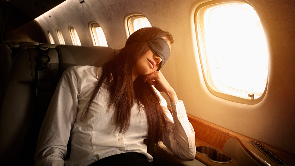 Why you should never lean against the window to sleep on a plane