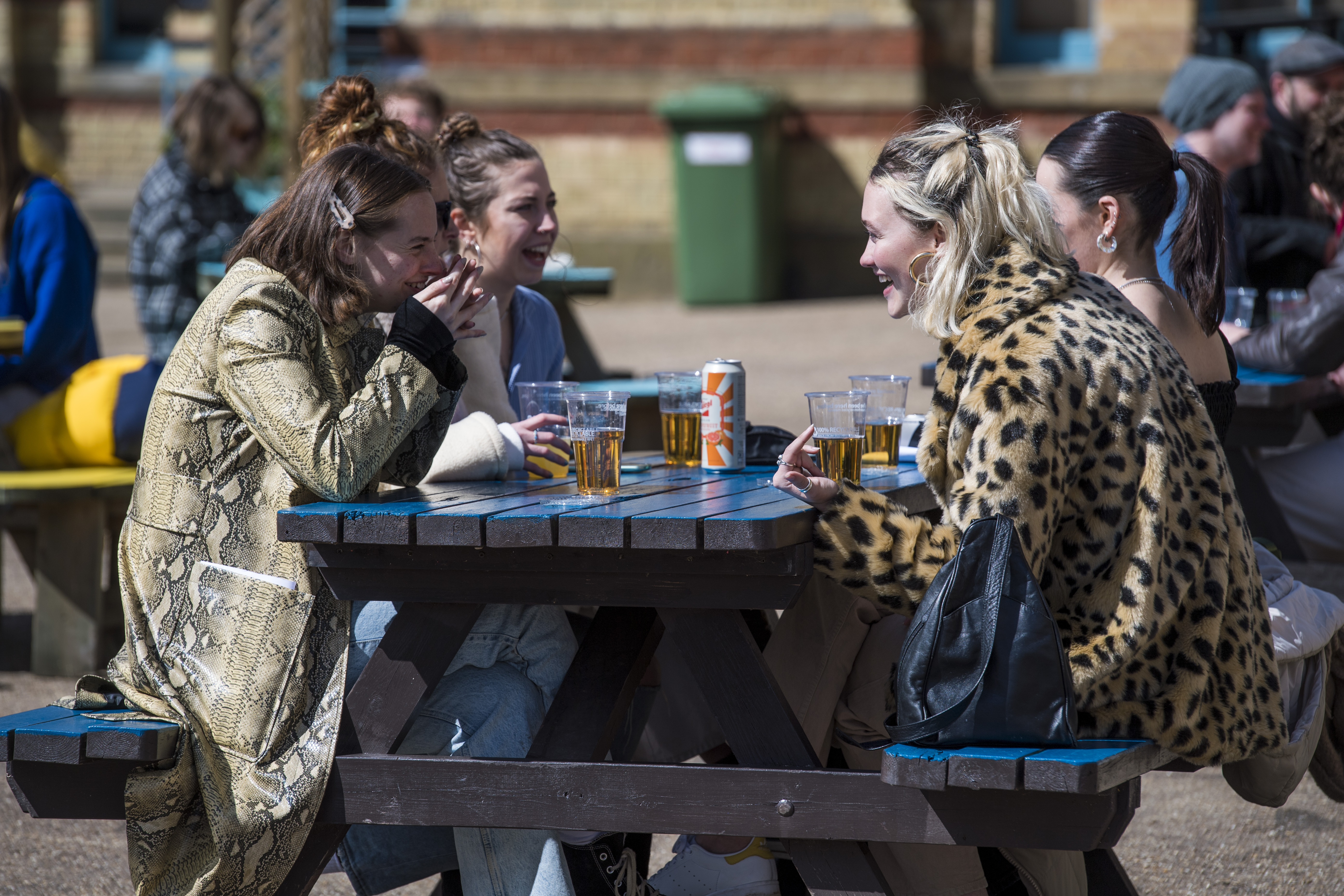 <p>Customers enjoy a drink at the reopening of the Terrace Bar at Alexandra Palace, London, as England takes another step back towards normality with the further easing of lockdown restrictions. Picture date: Monday April 12, 2021.</p>