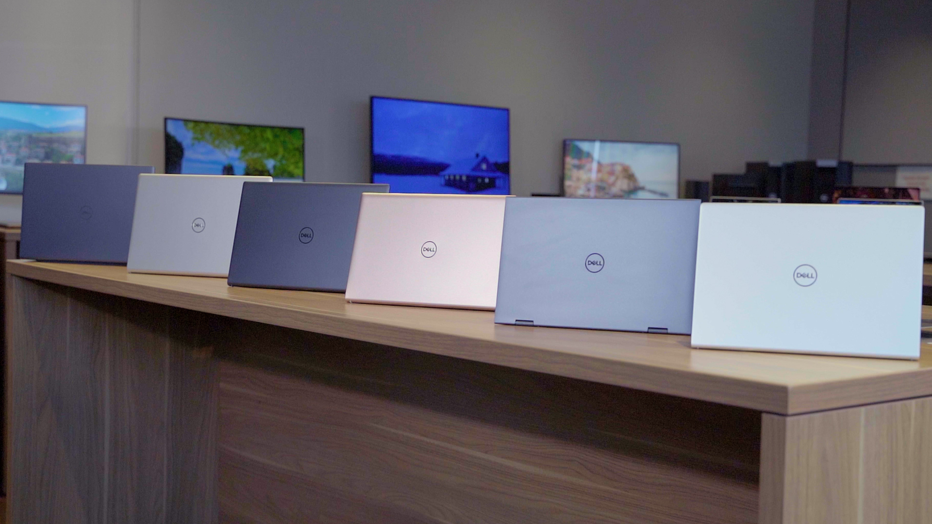 <p>Dell Inspiron redesign 2021. Six Dell Inspiron laptops laid out on a wooden table in gray, silver and copper colors.</p>