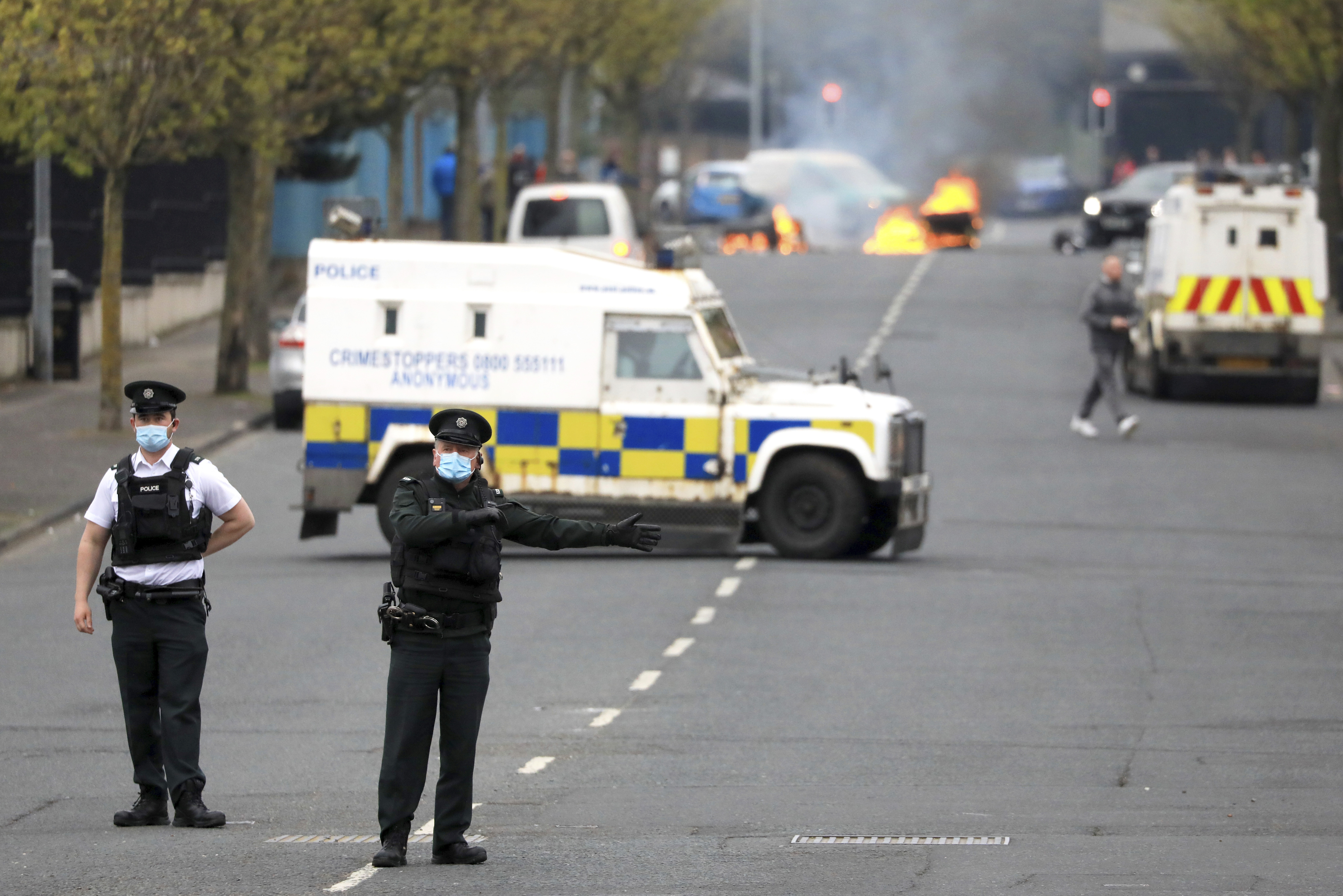 <p>Police divert traffic from a Loyalist protest in Lanark Way in West Belfast, Northern Ireland, Monday, April 19, 2021. Loyalist protesting on the Brexit agreement with the Northern Ireland Protocol have resumed across various locations in the British province. (AP Photo/Peter Morrison)</p>