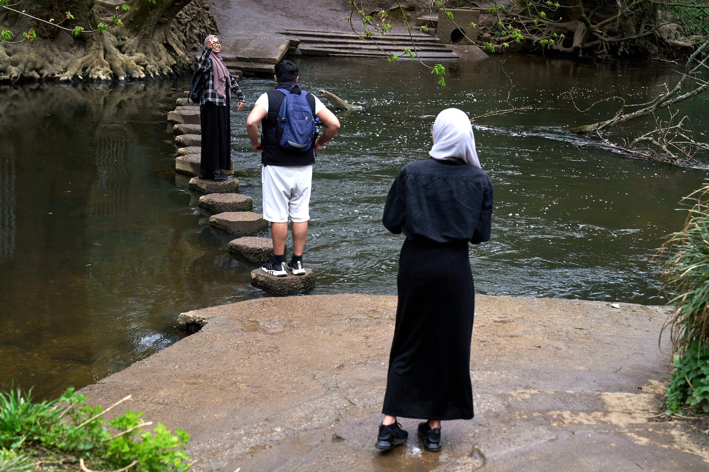 <p>People cross the stepping stones at Box Hill, Surrey during the spell of warm weather. Picture date: Wednesday March 31, 2021.</p>