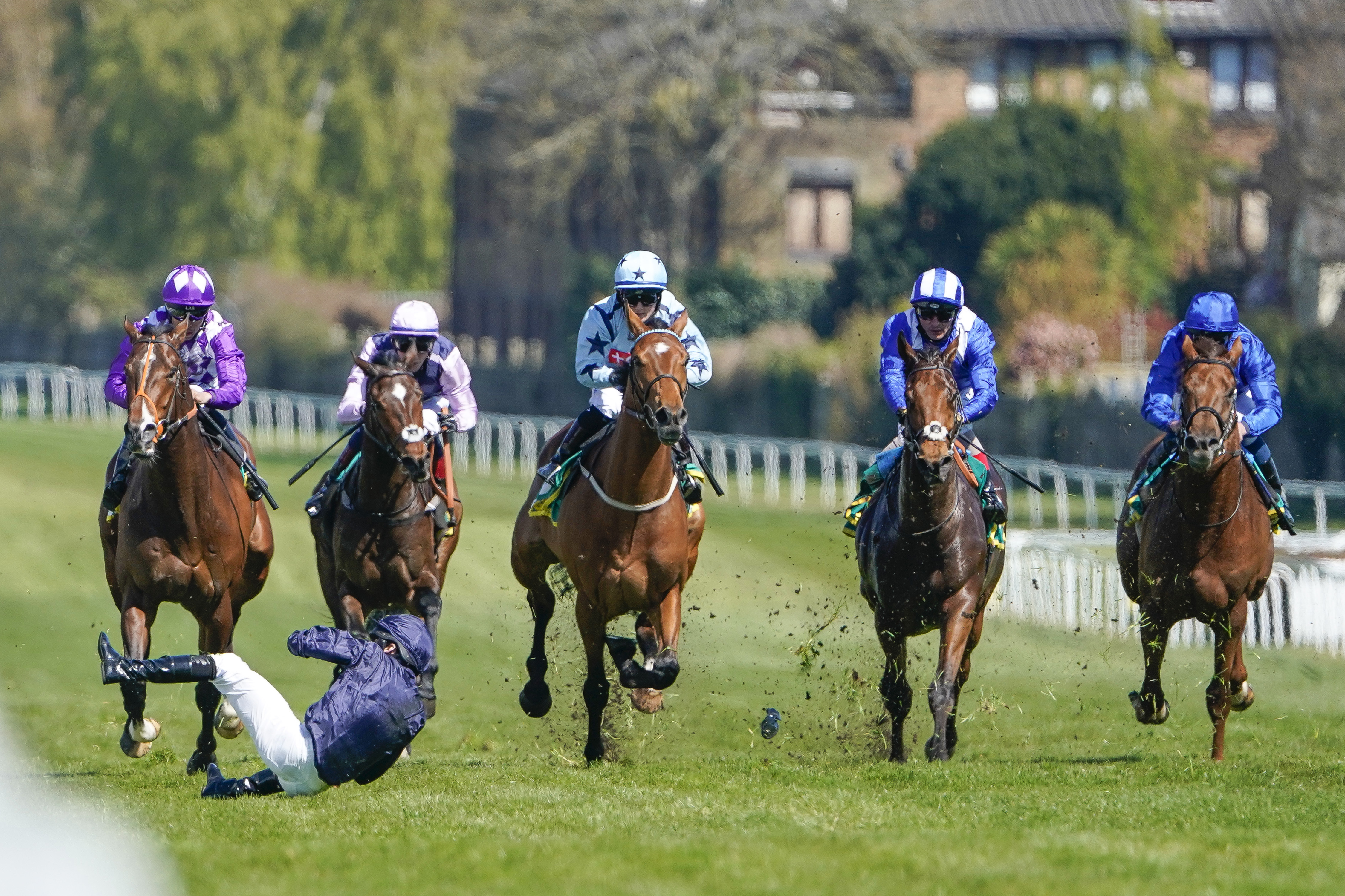 <p>ESHER, ENGLAND - APRIL 23: Ryan Moore falls from Rifleman after it veers when making its challenge inside the final furlong during The bet365 Esher Cup Handicap at Sandown Park Racecourse on April 23, 2021 in Esher, England. Sporting venues around the UK remain under restrictions due to the Coronavirus Pandemic. Only owners are allowed to attend the meeting but the public must wait until further restrictions are lifted. (Photo by Alan Crowhurst/Getty Images)</p>