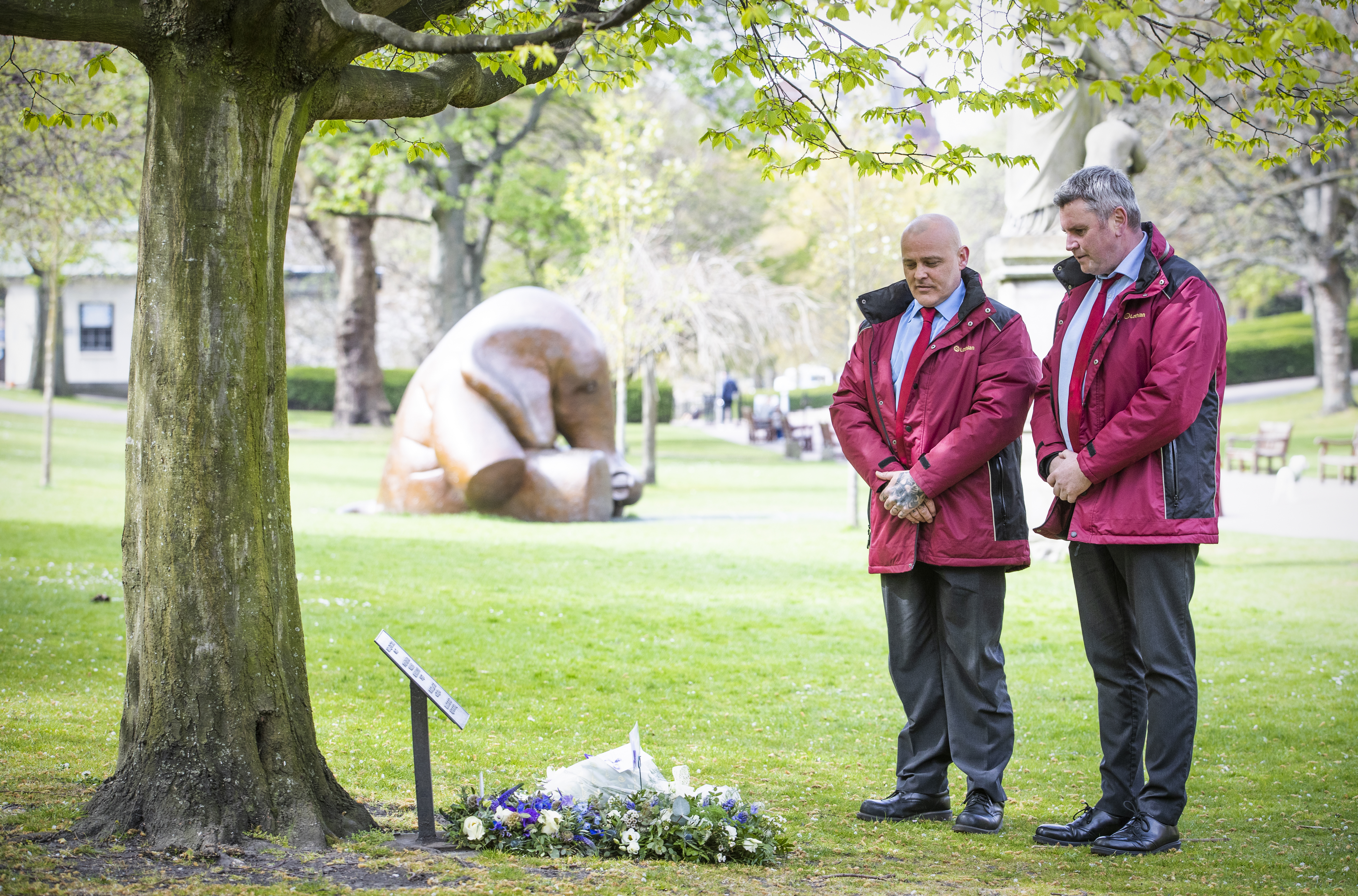 <p>George Brown (right) and Marvin Greenham, from Lothian Buses, reflect after laying a wreath at the workers memorial tree in West Princes Street Gardens, Edinburgh, to commemorate workers who died from Covid-19 and other illnesses or injuries as part of STUC International Workers Memorial Day. Picture date: Wednesday April 28, 2021.</p>