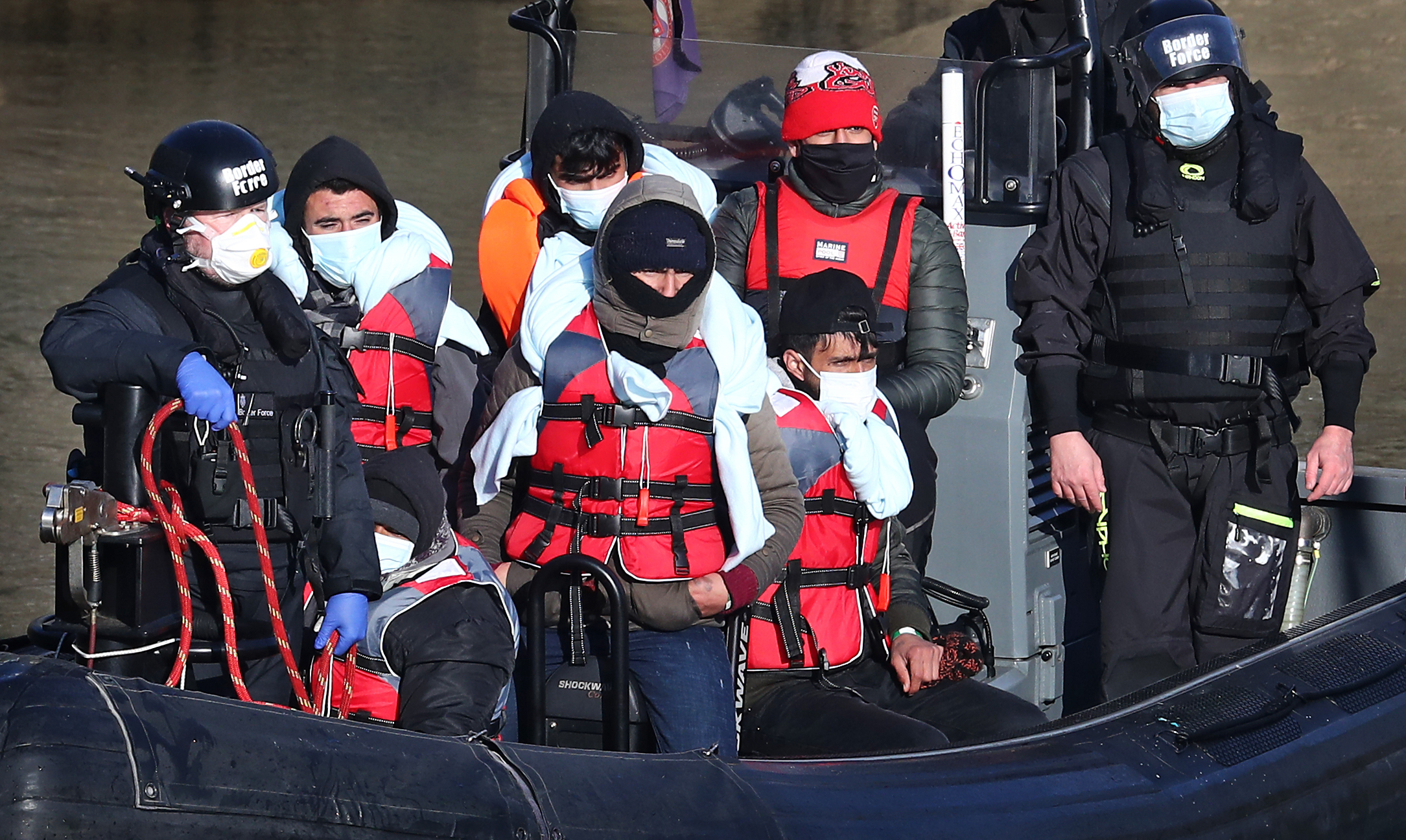 <p>A group of people thought to be migrants are brought in to Dover, Kent, by Border Force officers following a small boat incident in the Channel earlier this morning. Picture date: Tuesday April 13, 2021.</p>