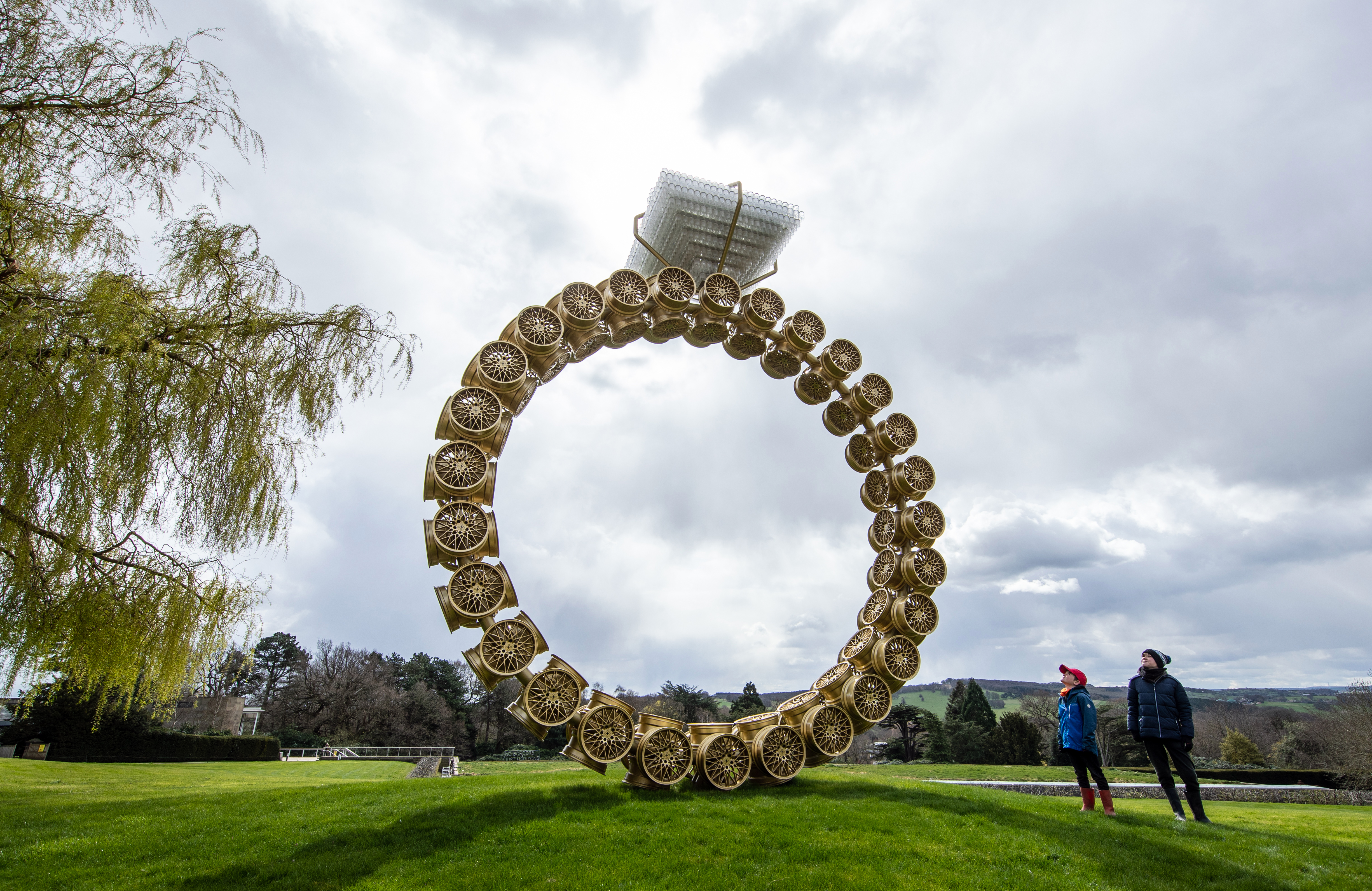 <p>Visitors Max Blyth (left) and Finton Blyth view a work titled 'Solitaire' by artist Joana Vasconcelos at the Yorkshire Sculpture Park (YSP). The grounds of the park are open and the YSP is looking forward to welcoming visitors back to other areas as soon as government restrictions allow. Picture date: Tuesday April 6, 2021. (Photo by Danny Lawson/PA Images via Getty Images)</p>
