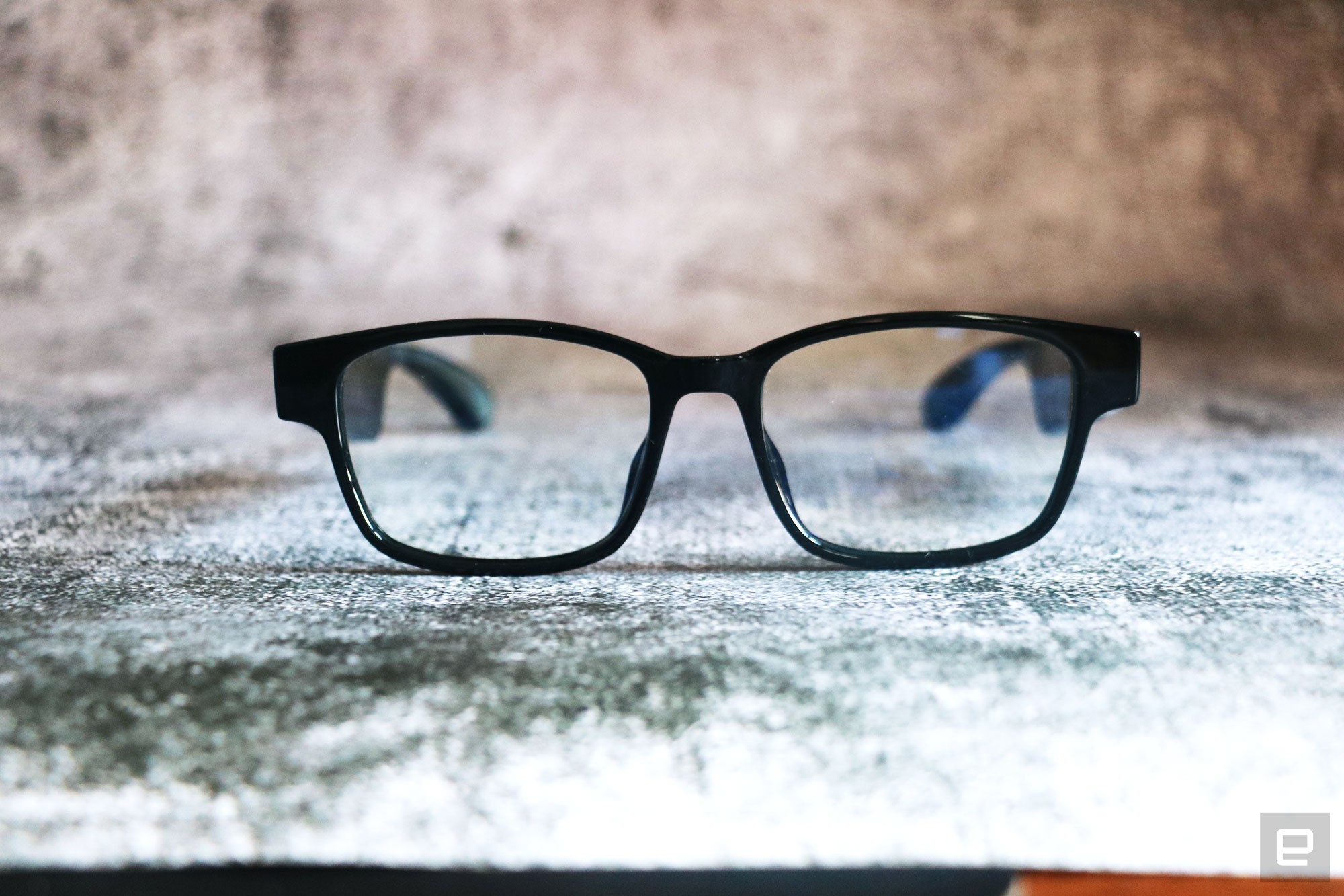 <p>Razer Anzu smart glasses review photo. Front view of the Razer smart glasses sitting on a desk with arms unfolded.</p>