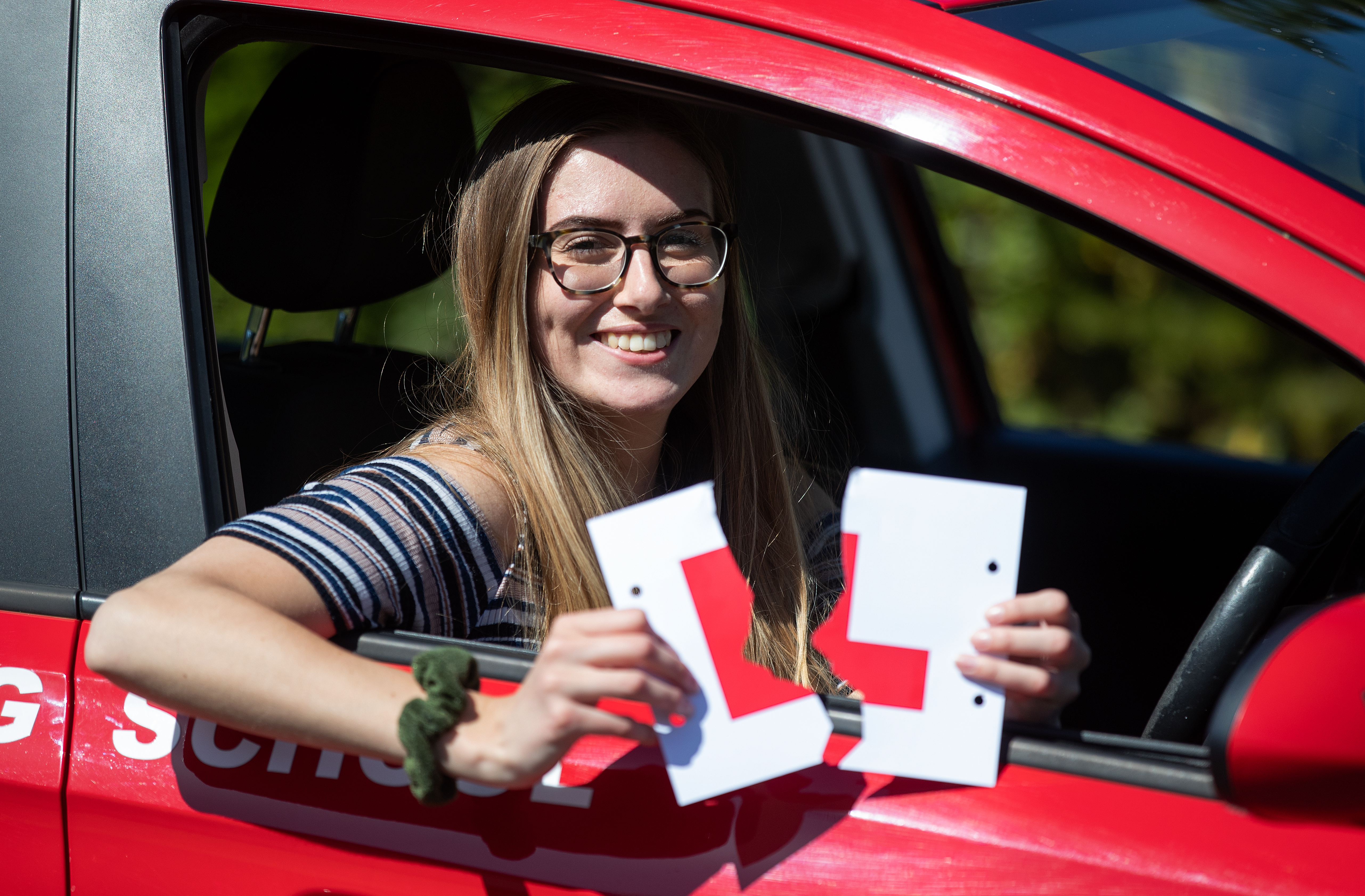 <p>Jade Bone, 24, celebrates passing her driving test at a test centre in Southampton, Hampshire, where examinations have resumed under the latest easing of lockdown restrictions. Driving tests have been suspended throughout the UK since early January but restart in England and Wales today. Picture date: Thursday April 22, 2021.</p>